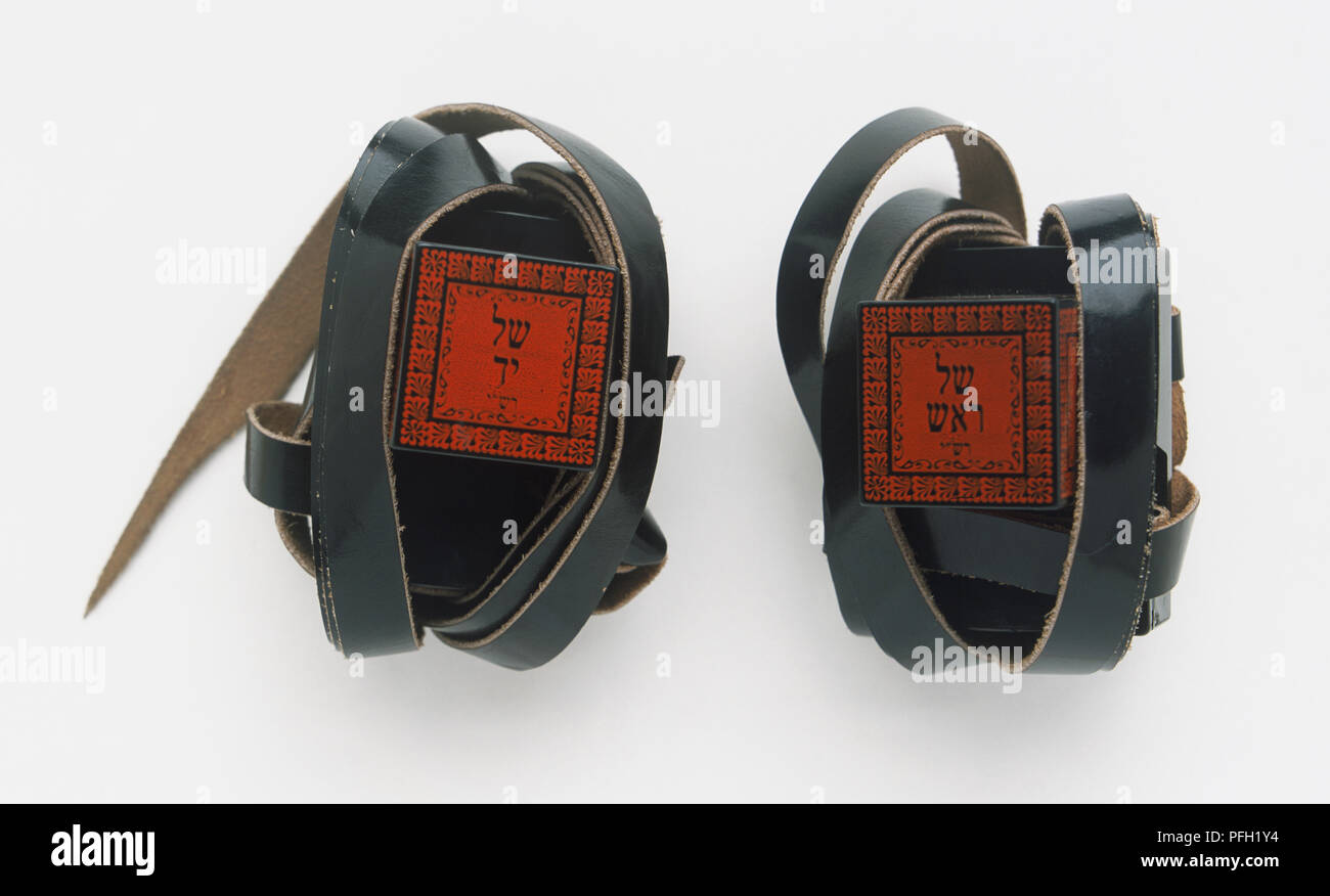 Two tefillins orphylacteries, small leather cases containing texts from the Hebrew Scriptures traditionally worn by Jewish men during morning prayer. - Stock Image