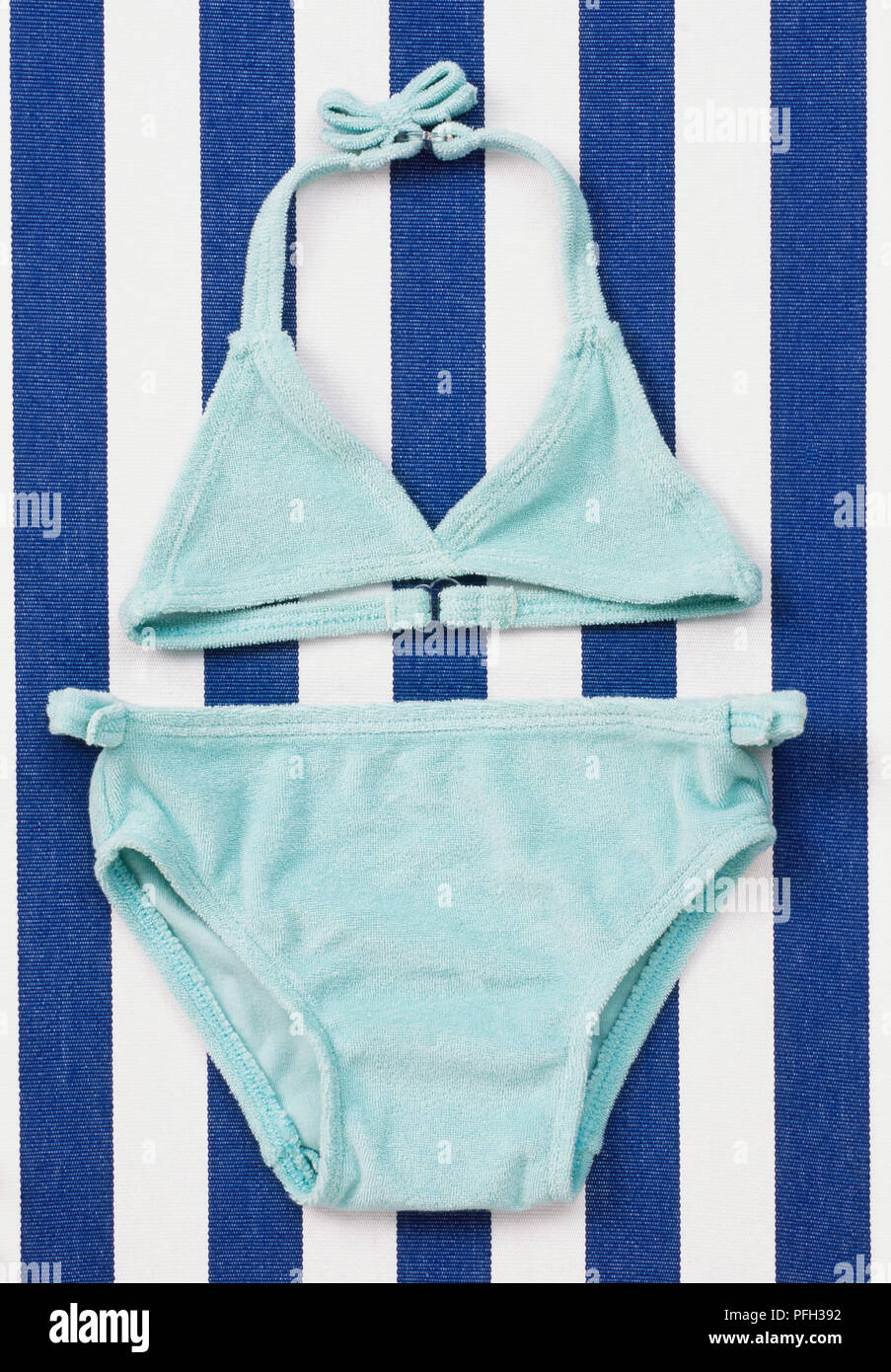 Girl\'s blue two-piece bathing suit on a deck chair Stock Photo ...