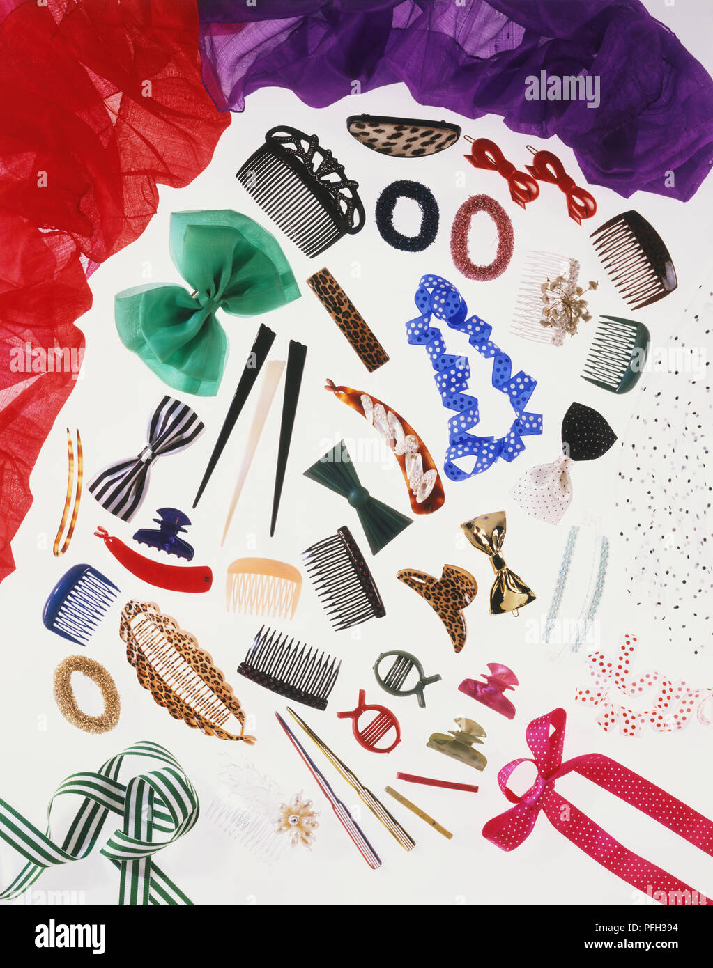 Selection of hair accessories, including clips, grips, pins, sticks, combs and ribbons - Stock Image