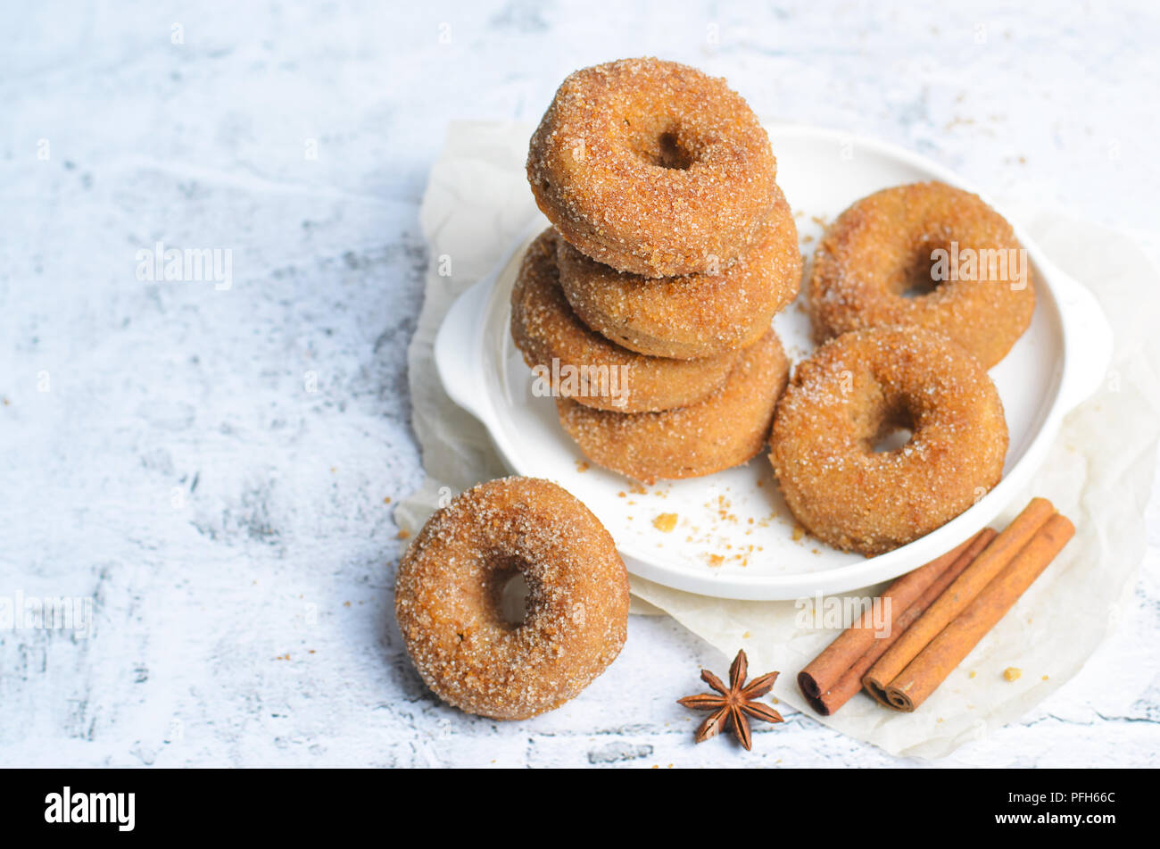 Cinnamon Donuts, Freshly Baked Homemade Doughnuts Covered in Sugar and Cinnamon Mixture,