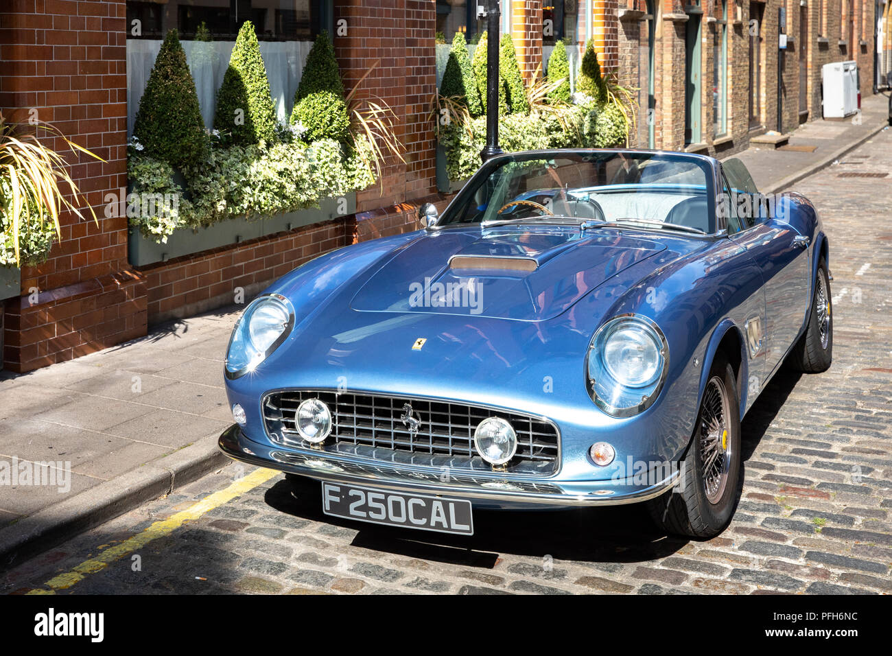 Vintage Ferrari convertible car. - Stock Image
