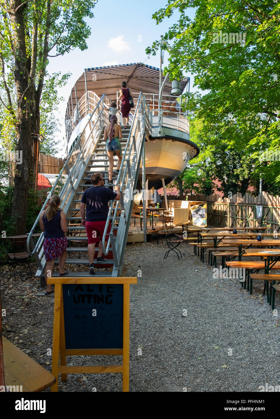 Alte Utting, former  passenger ship converted to a restaurant now placed on a railway bridge in Munich,Germany. - Stock Image