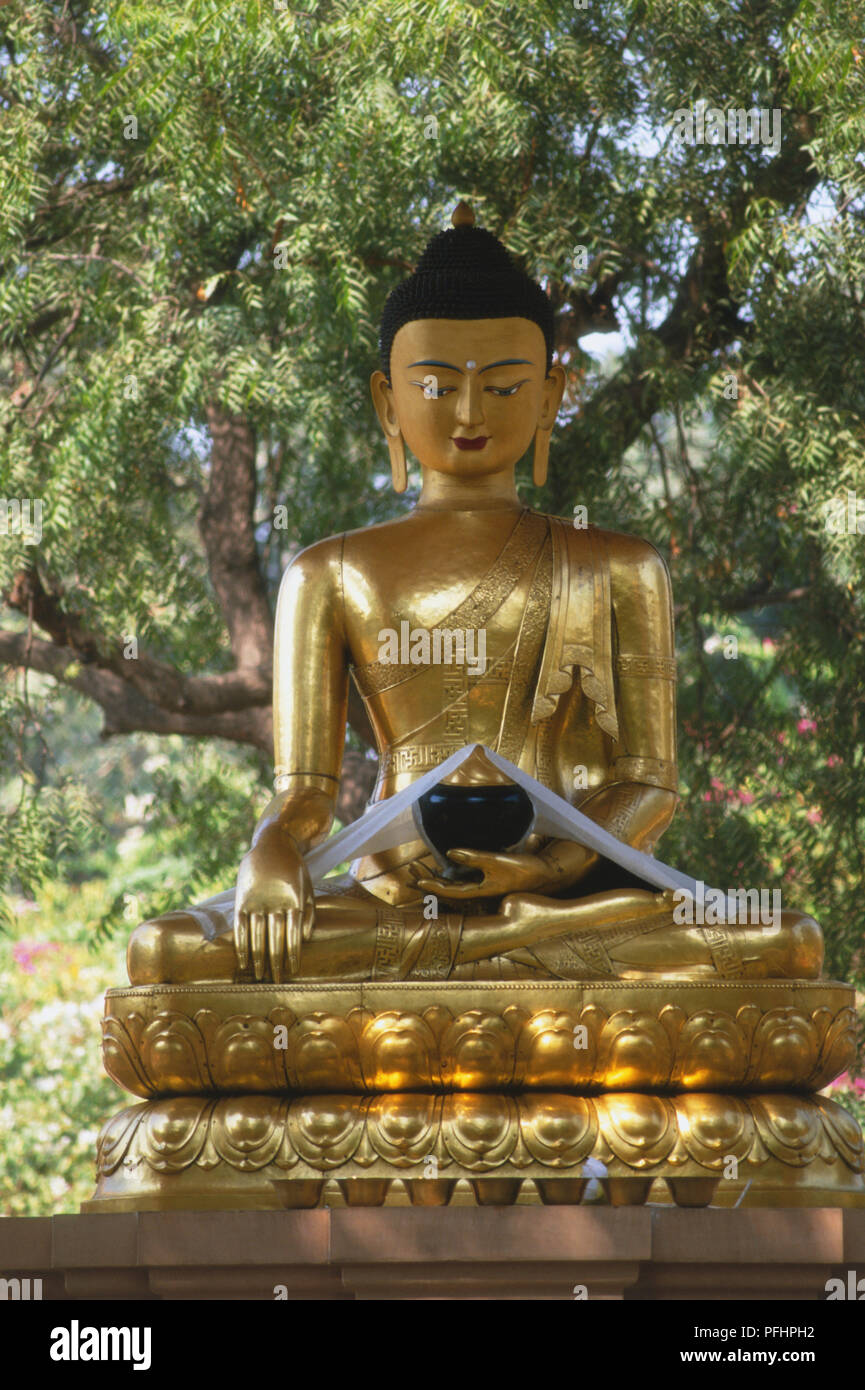 India golden statue of seated buddha meditating on lotus flower india golden statue of seated buddha meditating on lotus flower pedestal a gift to the indian people from spiritual leader of tibet the dalai lama izmirmasajfo
