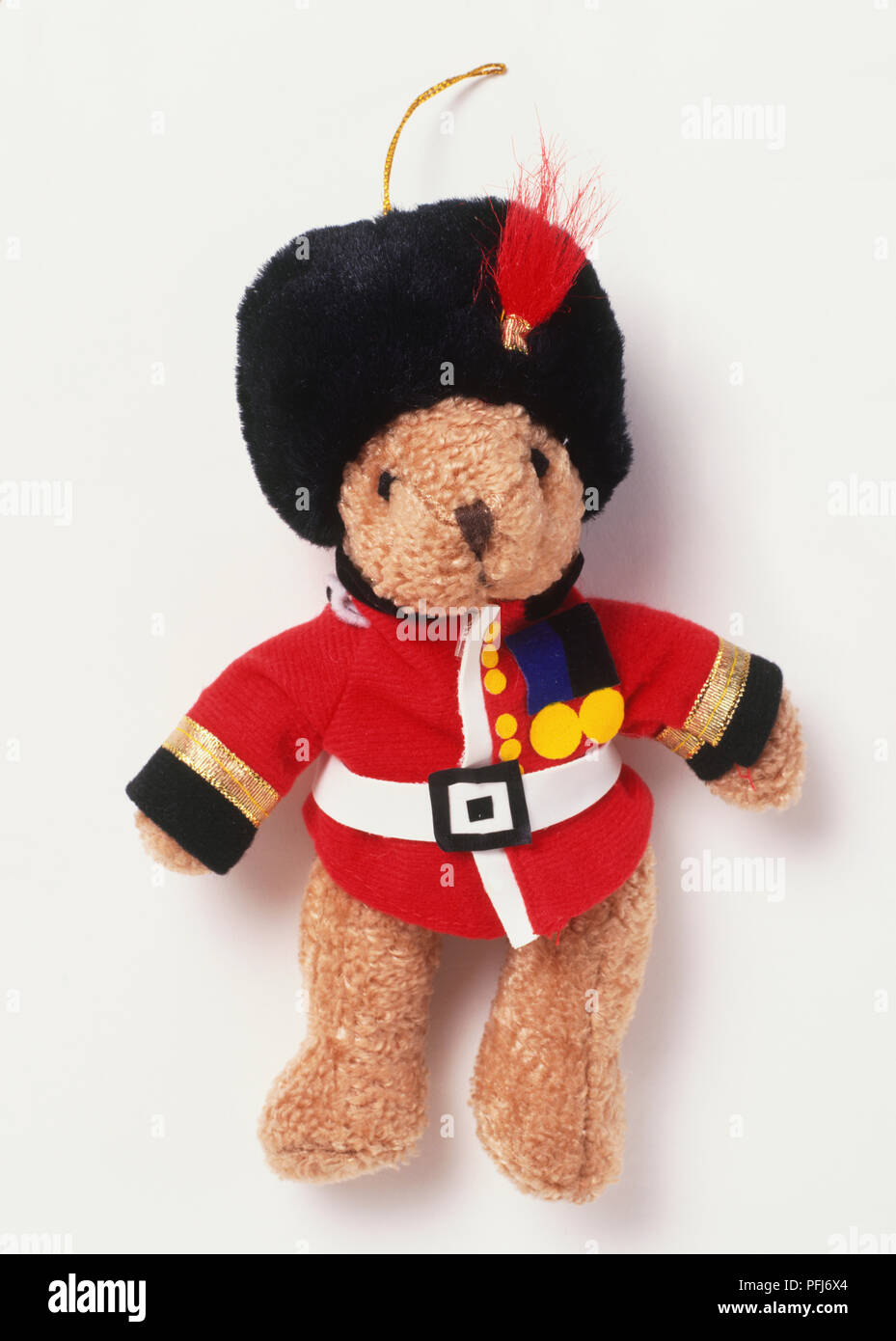 ec530338 Teddy bear dressed in traditional furry black hat and red jacket of ...