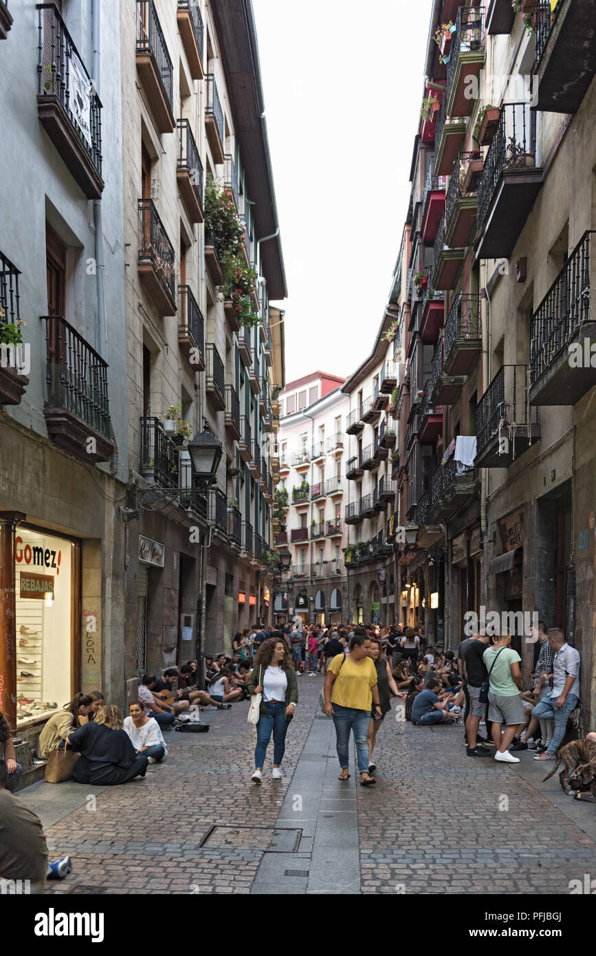 People in the streets and bars of the historic city of Bilbao, Spain. - Stock Image