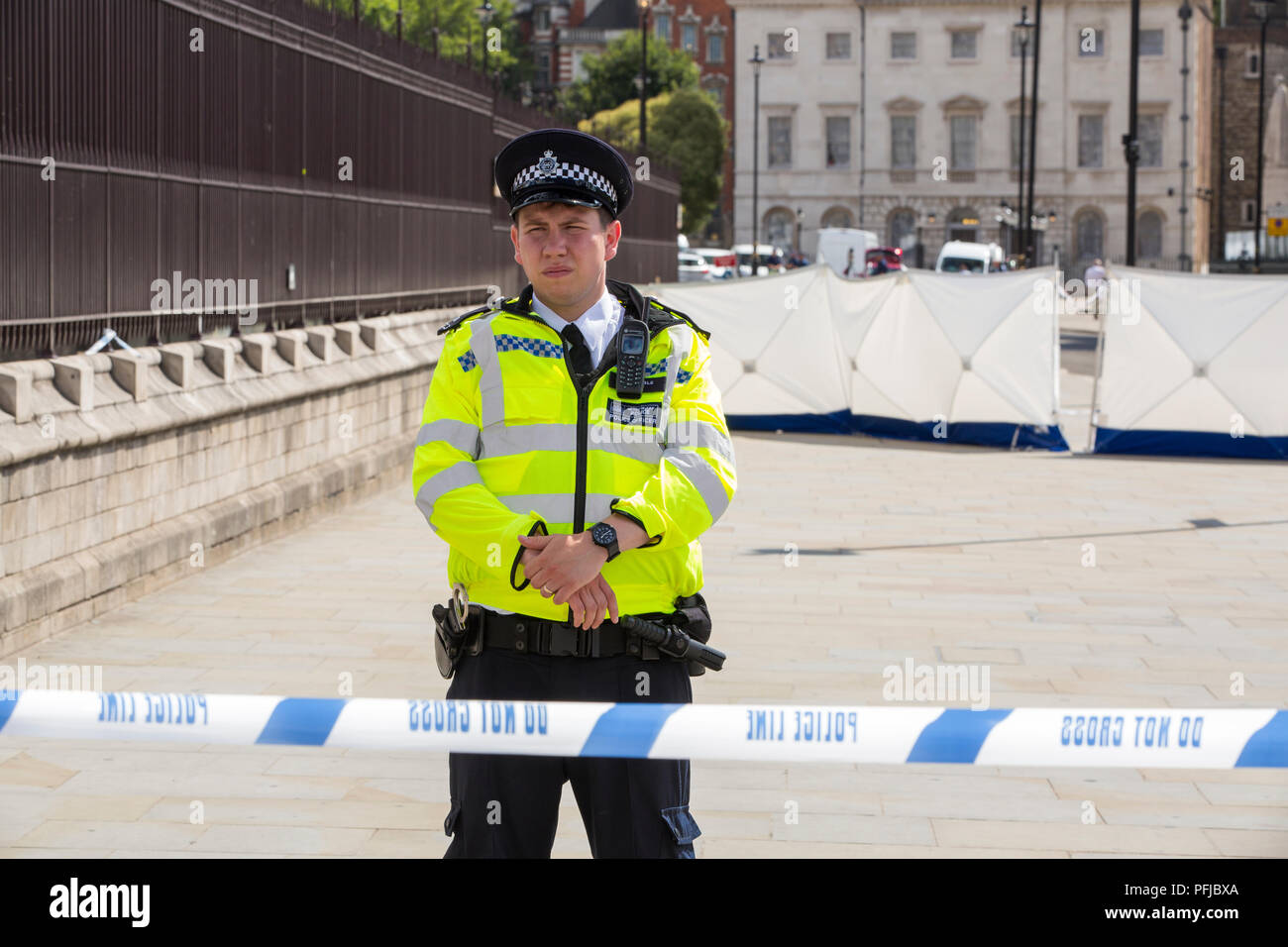 Police barriers, sheild the aftermath of the latest incident where a man used a car to deliberately target pedestrians outside the Houses of Parliamen - Stock Image