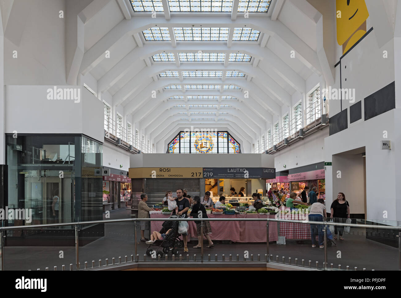 View of the stands in the market hall Ribera, Bilbao, Spain. - Stock Image