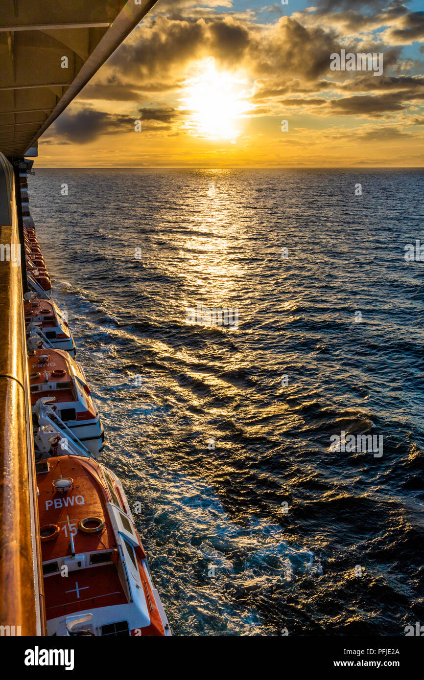 A sunset over the NW Pacific coast near Prince of Wales Island, Alaska, USA - Viewed from a cruise ship sailing the Inside Passage - Stock Image