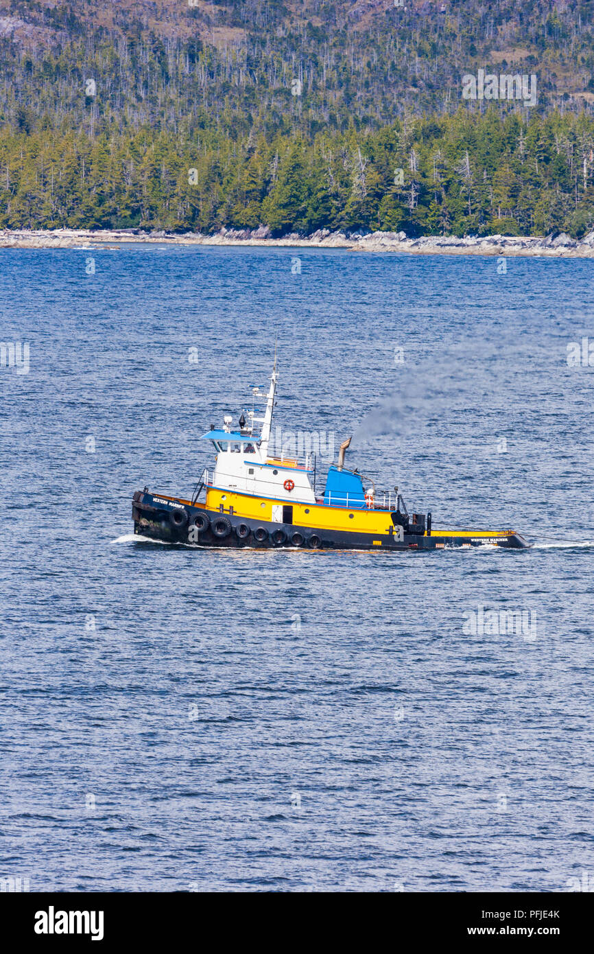 The ocean tug boat Western Mariner on the NW Pacific coast off Campania Island, British Columbia, Canada - Viewed from a cruise ship sailing the Insid - Stock Image