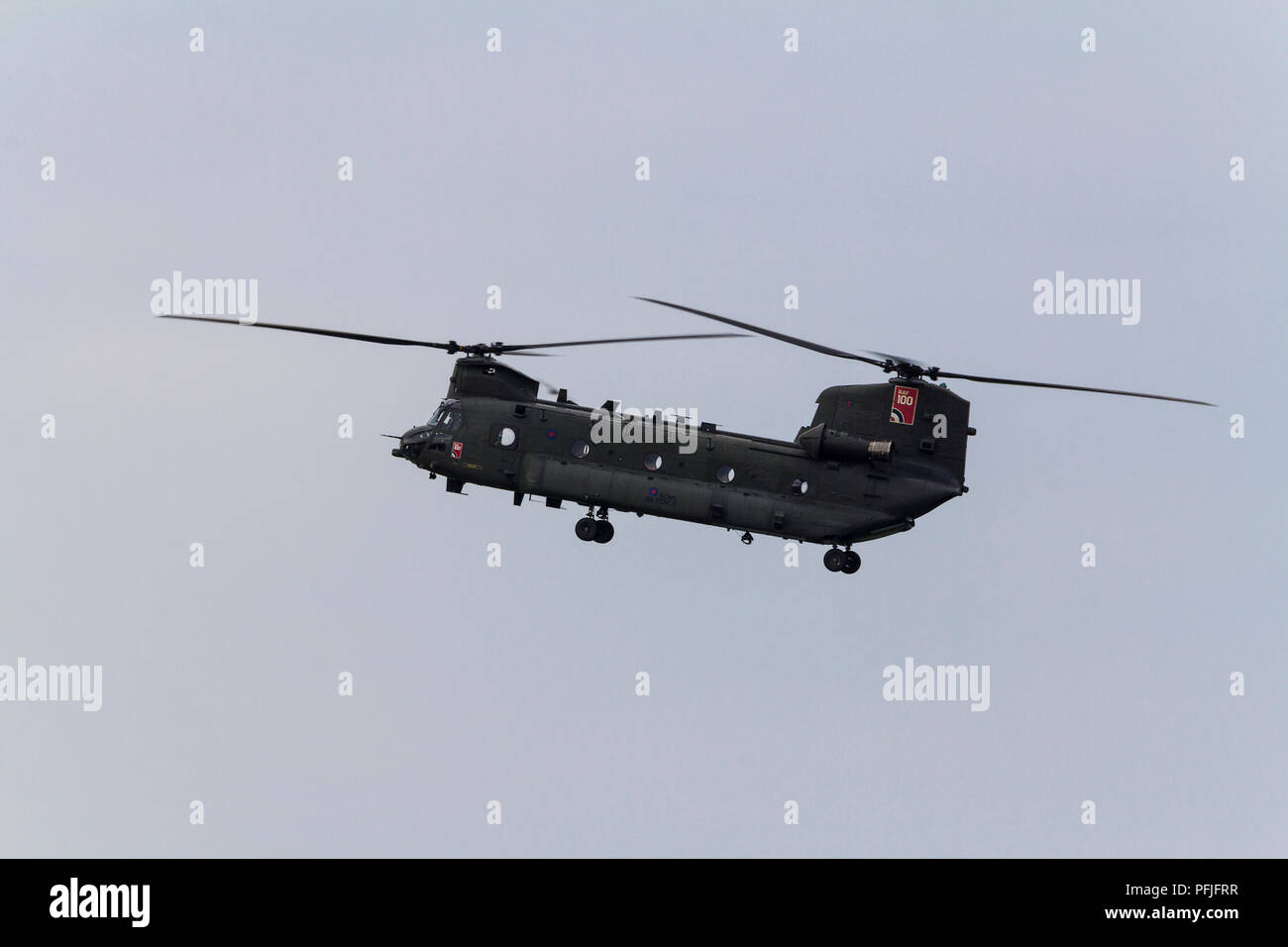 Chinook helicopter flying over shoreham UK coastal area. Vertical lift off and hovering heavy duty twin engine tandem rotors RAF transport aircraft. - Stock Image