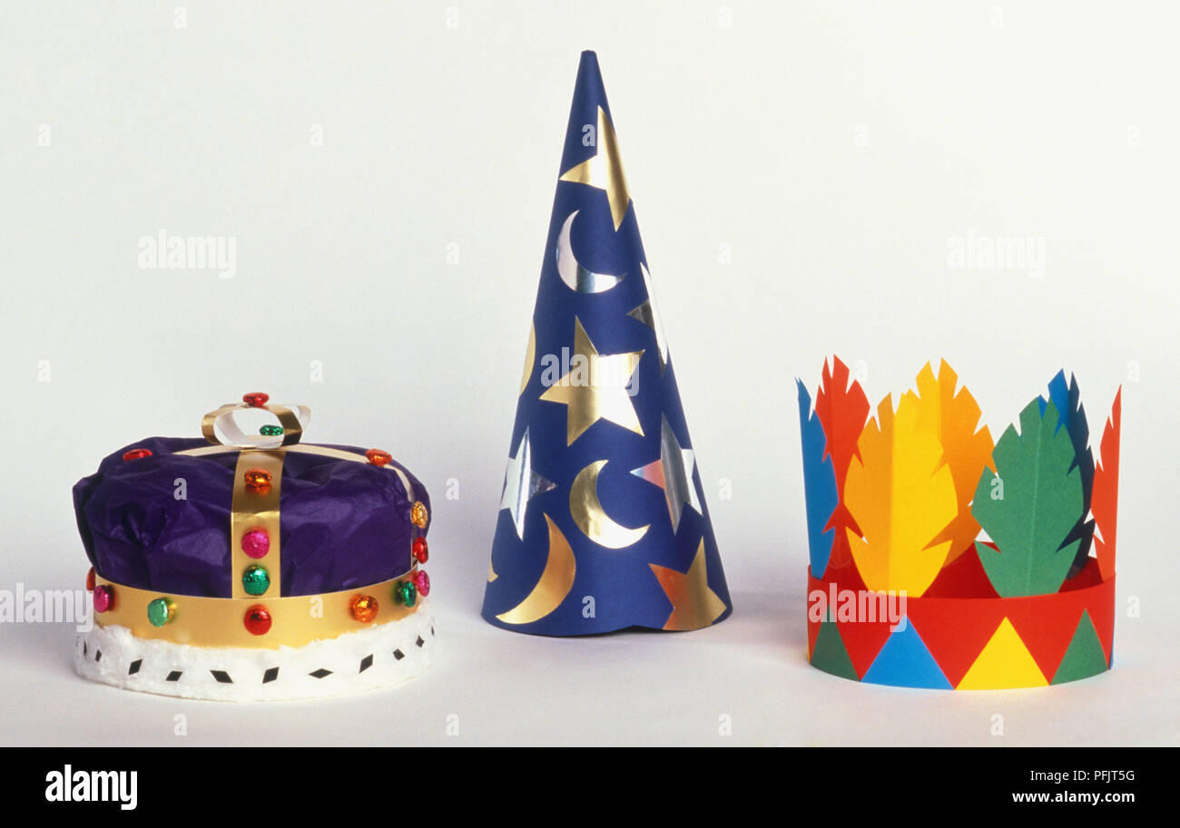 King's crown, magician's hat and feather crown, front view - Stock Image