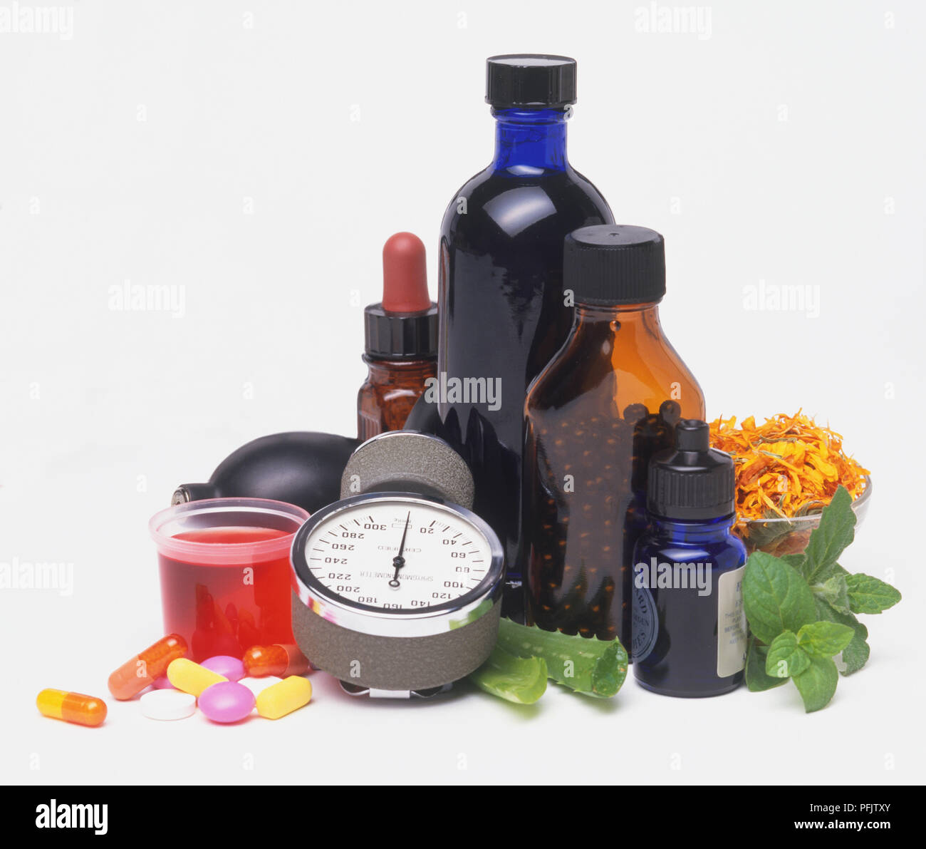 Alternative medicine, including bottles, capsules, Sphygmomanometer - Stock Image