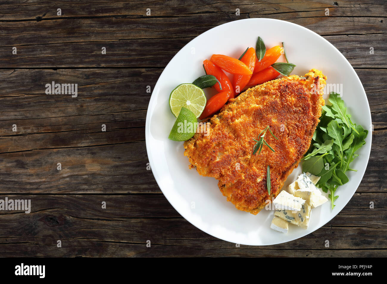 Fried Breaded White Fish Steak Served On White Plate With