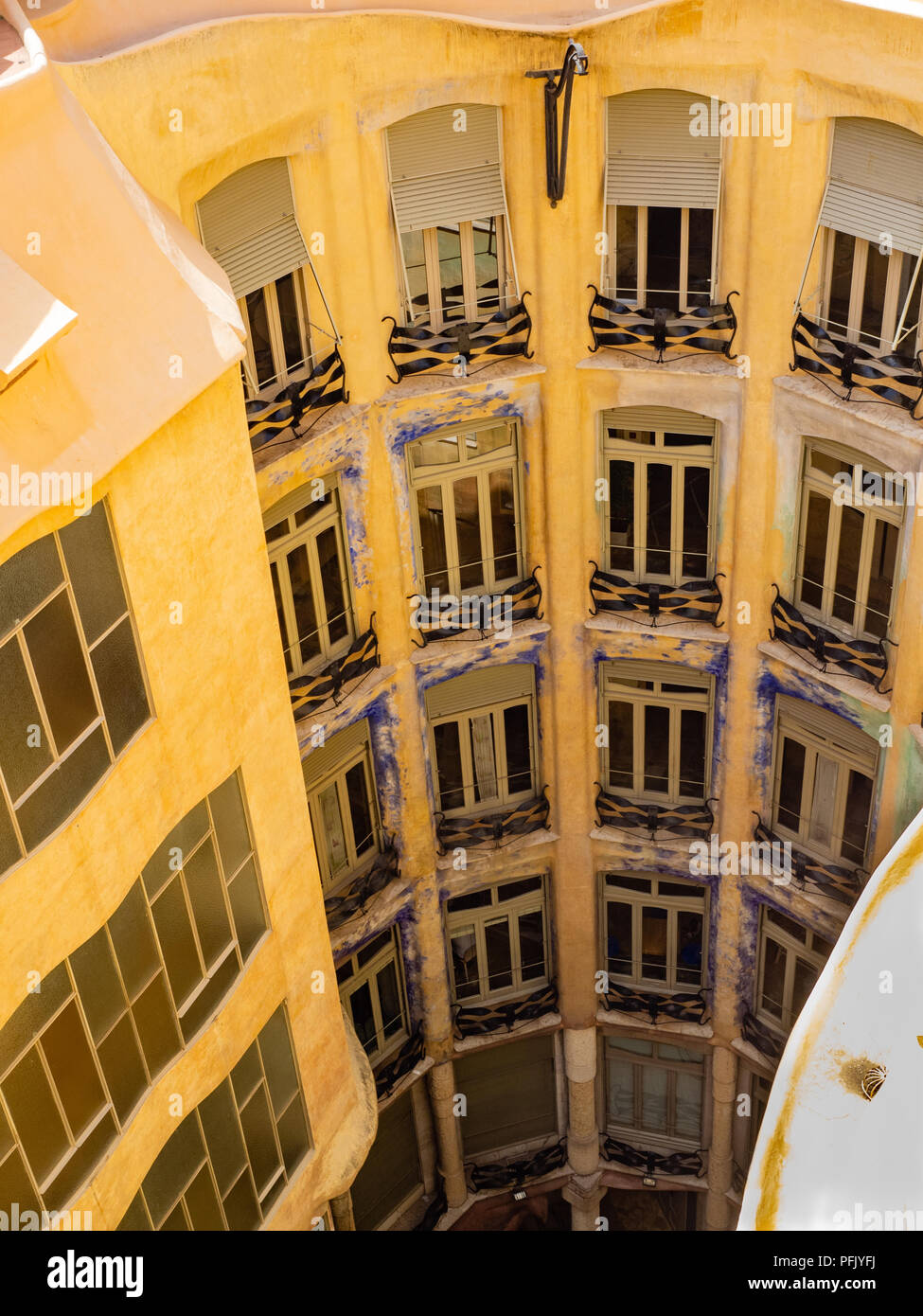 Former offices and apartments at Antoni Gaudi's La Pedrera - Casa Milà, Barcelona, Catalonia, Spain. - Stock Image
