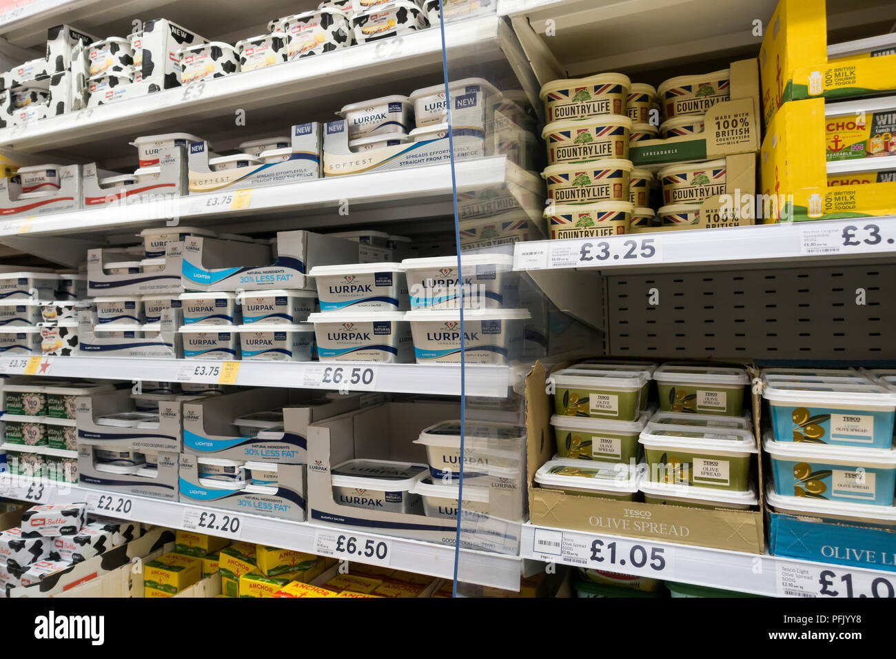 Butter and spreads for sale on supermarket shelves, England, UK - Stock Image
