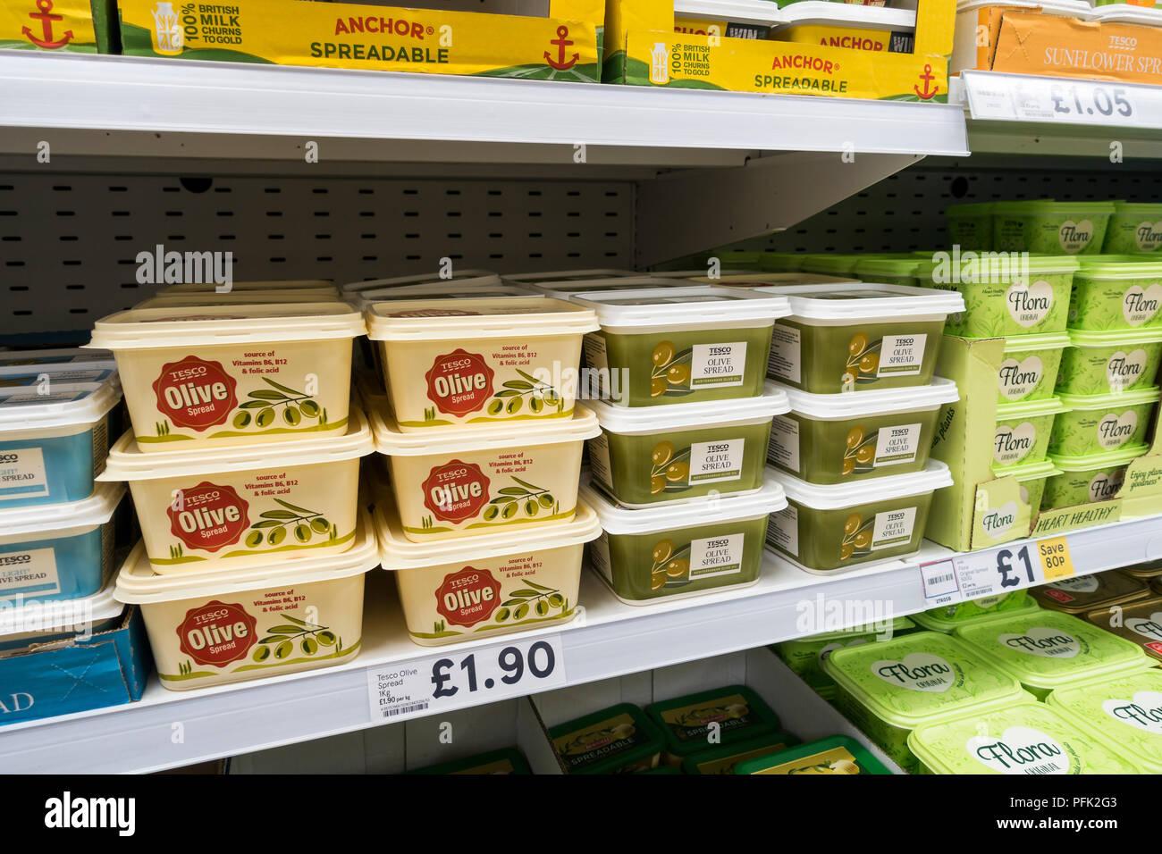 Olive oil spreads on display, for sale on supermarket shelves, United Kingdom - Stock Image