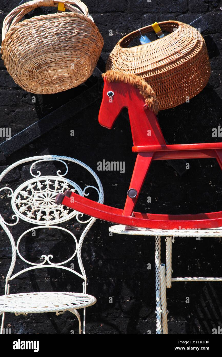Great Britain, England, woven baskets, wrought iron chair and rocking horse  on antiques stall - Great Britain, England, Woven Baskets, Wrought Iron Chair And