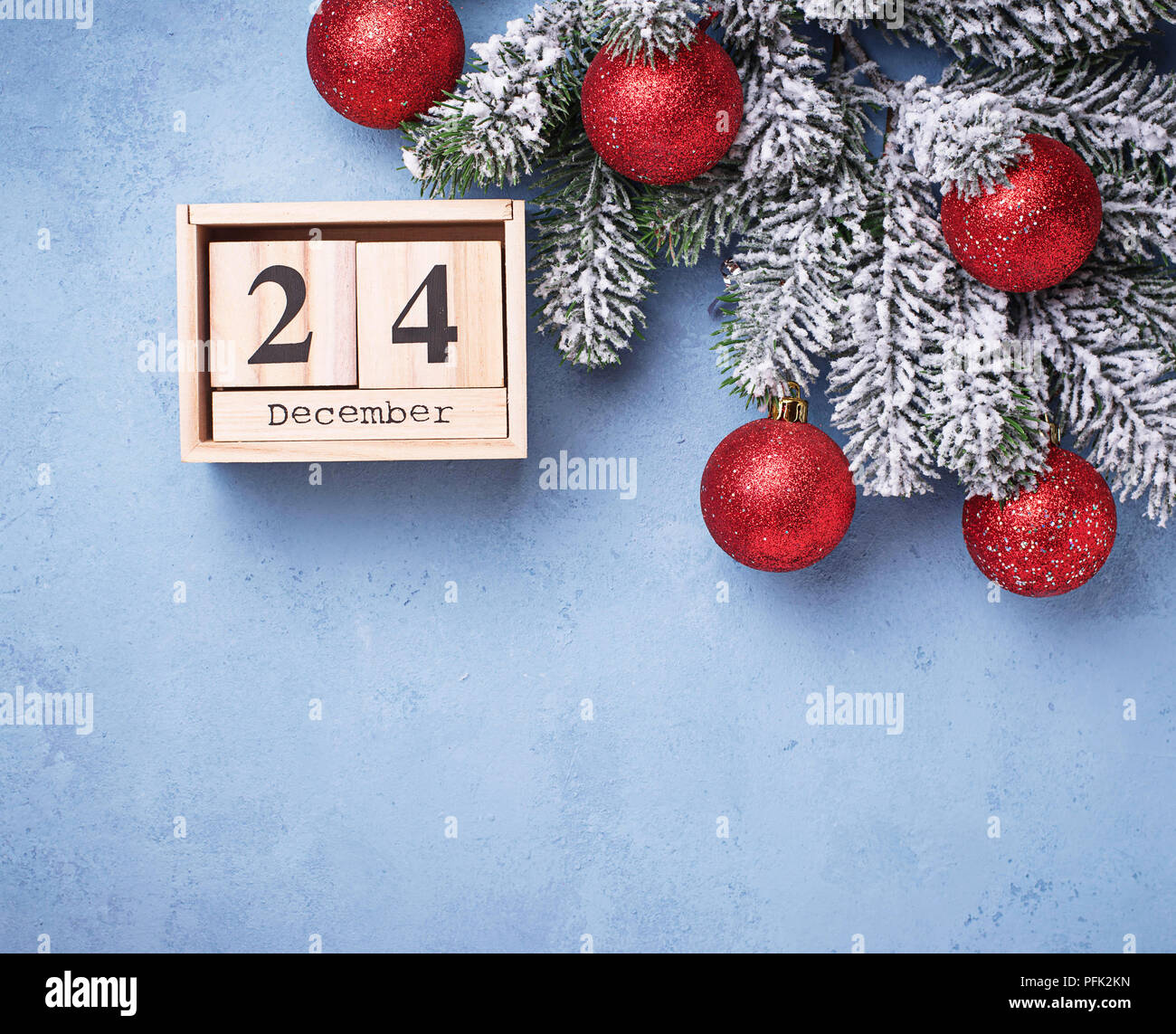 24 December on wooden calendar - Stock Image