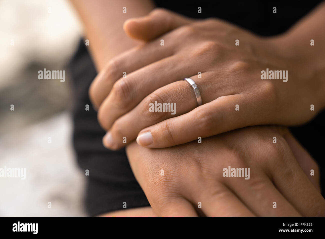 engagement ring on females hand after wedding proposal - Stock Image
