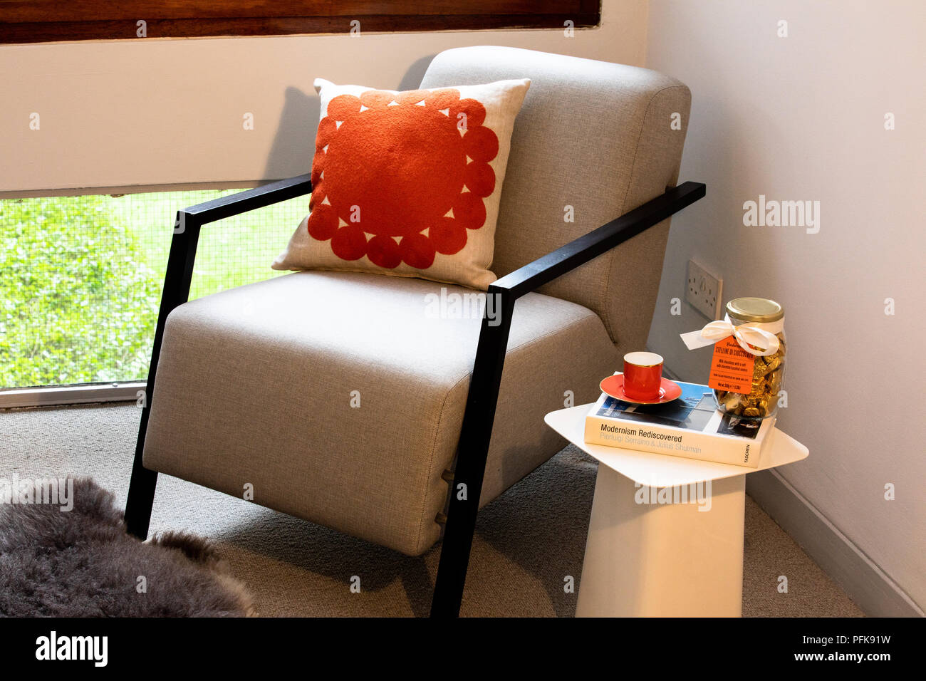 Mid Century Chair In City Apartment With Throw Cushion And Vitra