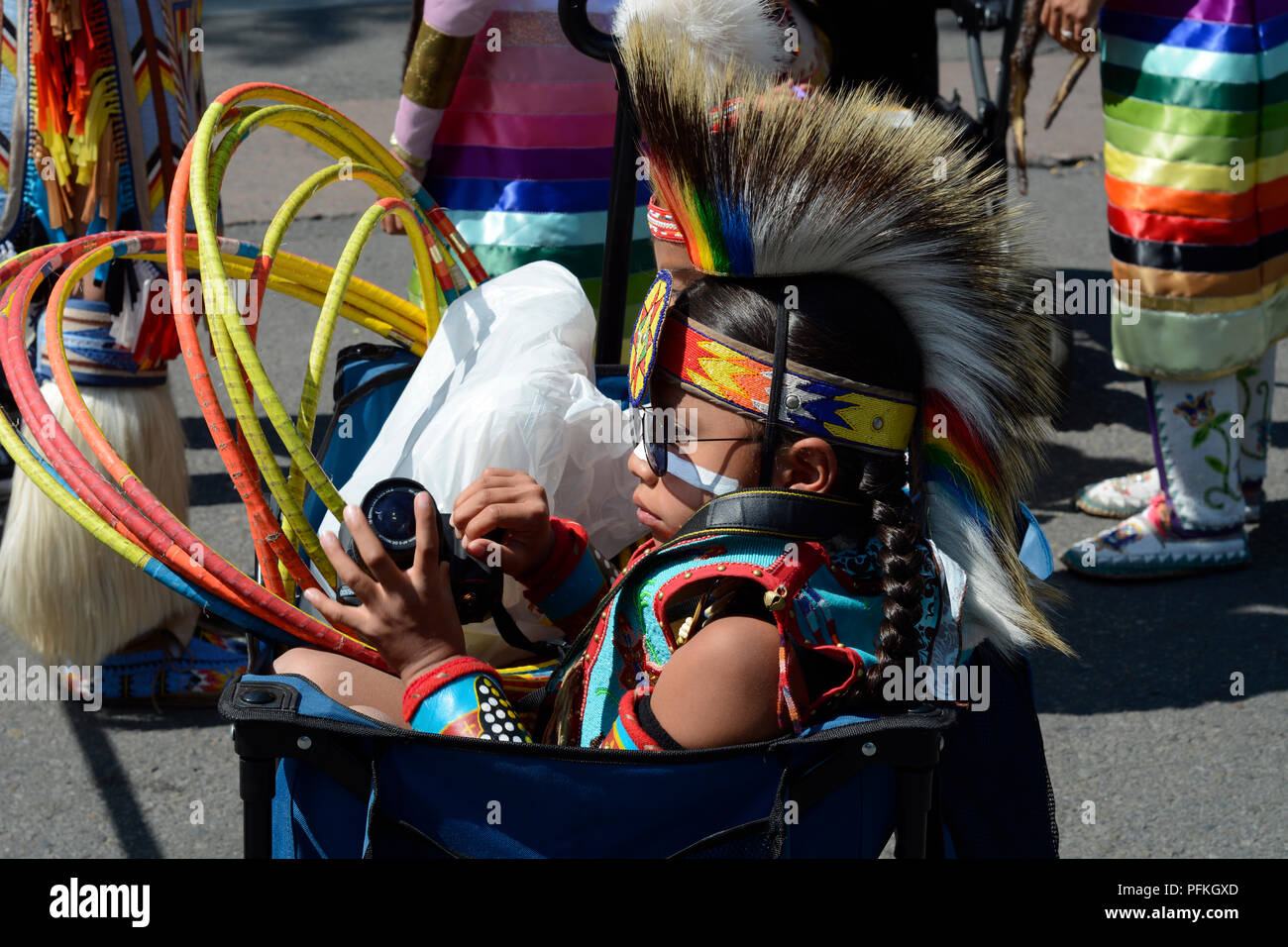 A young Native-American boy wearing traditional Plains Indian regalia at the Santa Fe Indian Market. - Stock Image