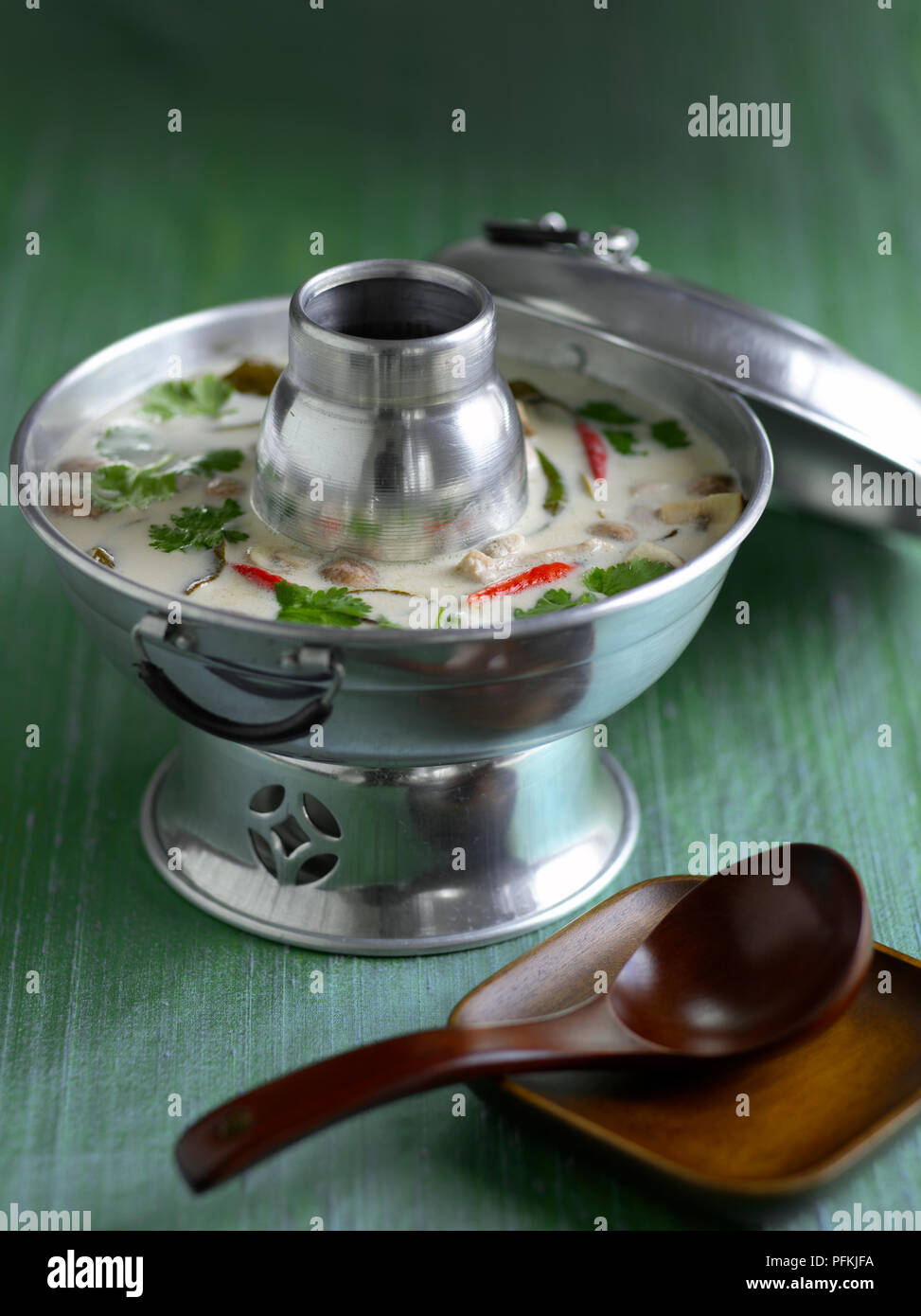 Tom Kha Gai Spicy Chicken And Coconut Soup In Thai Hot Pot Serving Bowl Spoon Nearby Stock Photo Alamy
