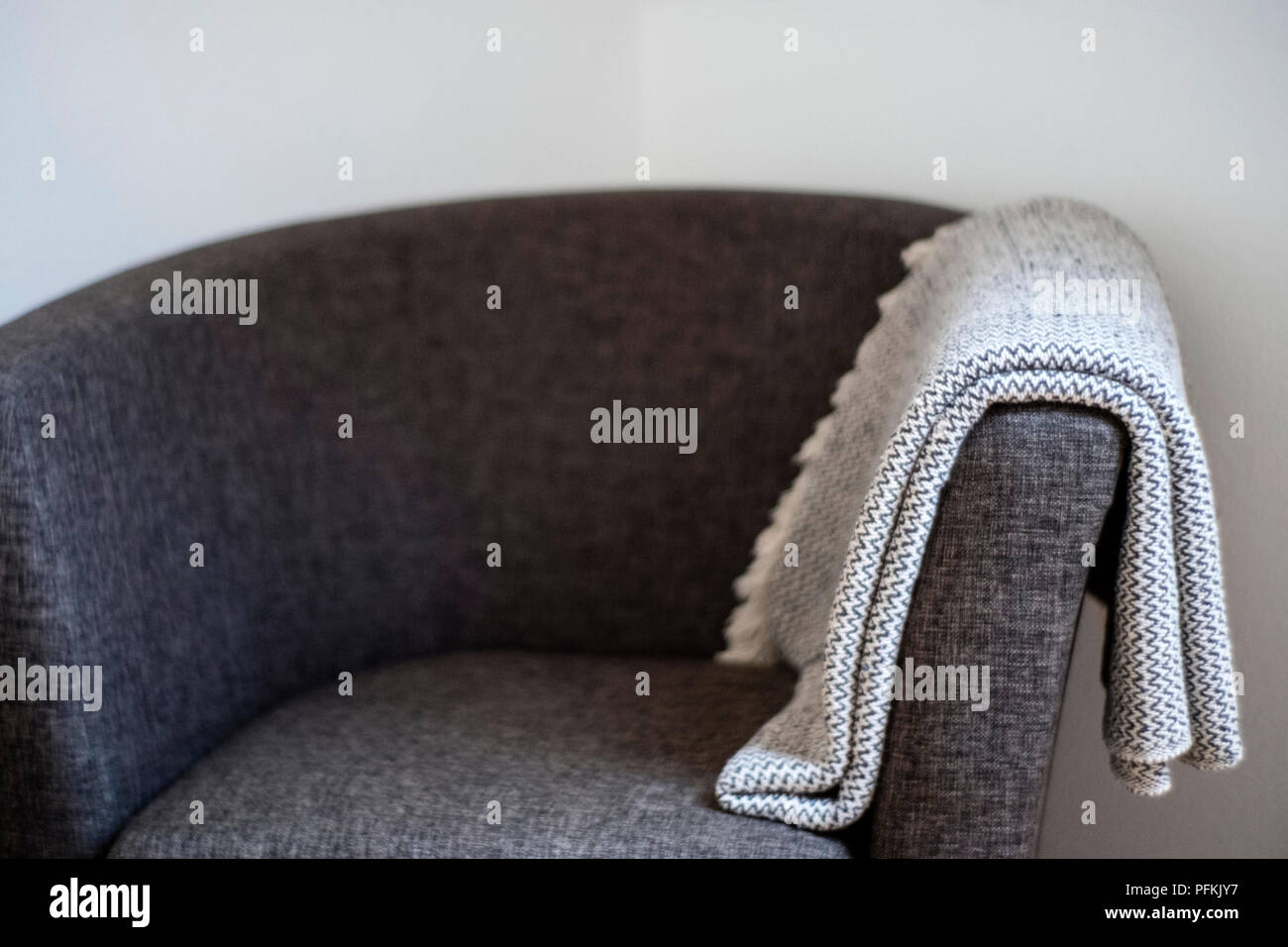 Blanket on a sofa - Stock Image