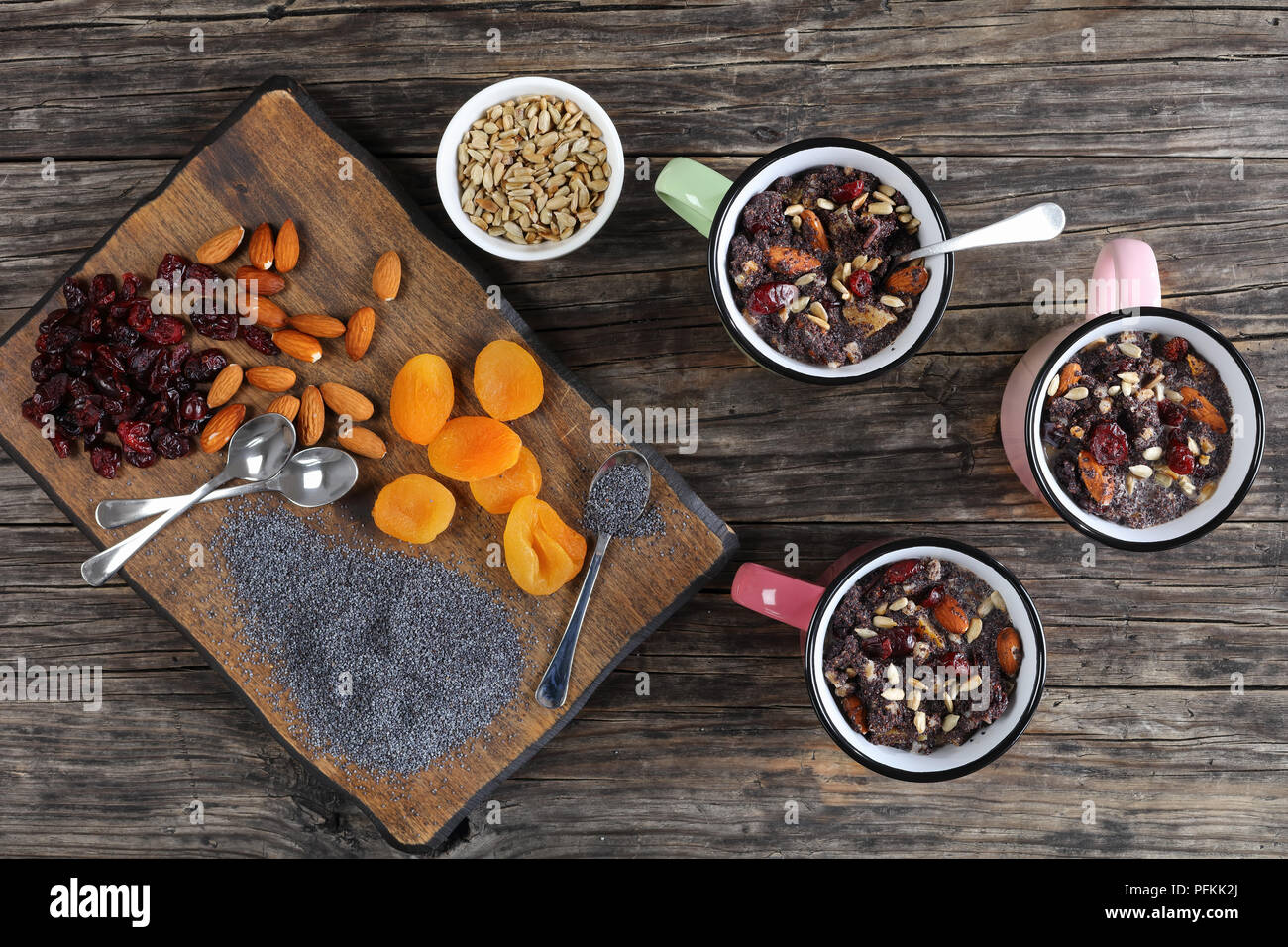 delicious christmas dessert of poppy seeds mixed with dried fruits and nuts served in cups - traditional eastern europe holiday dish, horizontal view  - Stock Image