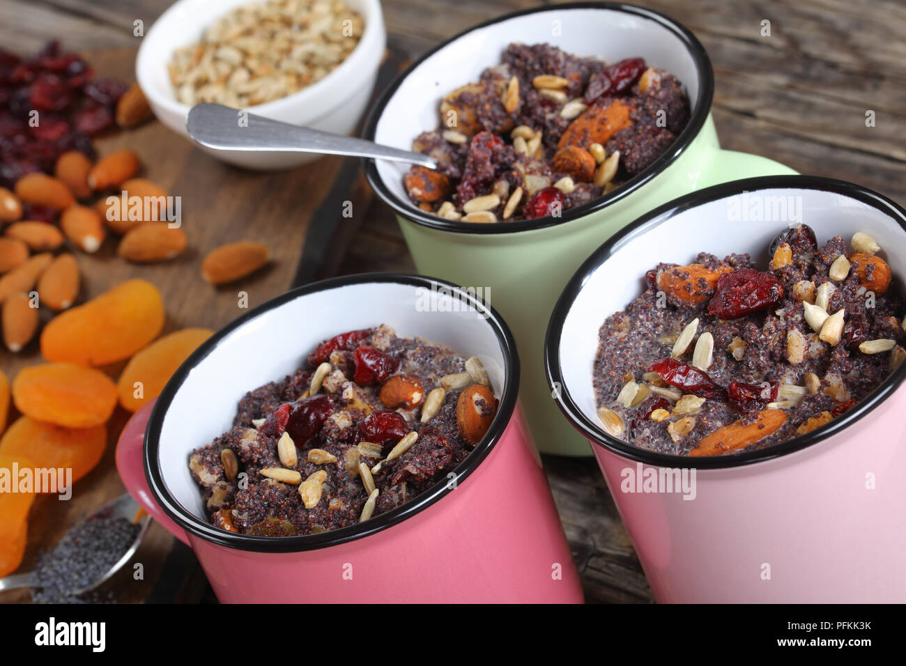 close-up of delicious christmas dessert or kutia of poppy seeds mixed with cooked whole wheat, dried fruits and nuts served in cups, view from above - Stock Image