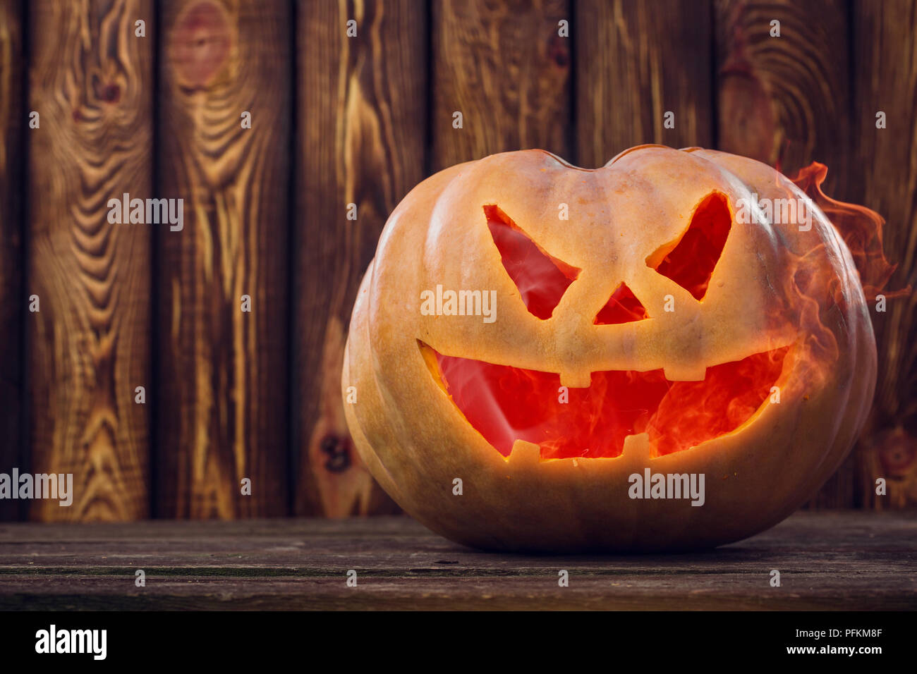 halloween pumpkin design with copy space on wooden background stock