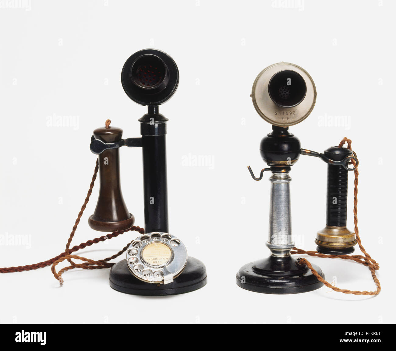 Two antique candlestick telephones, front view - Stock Image