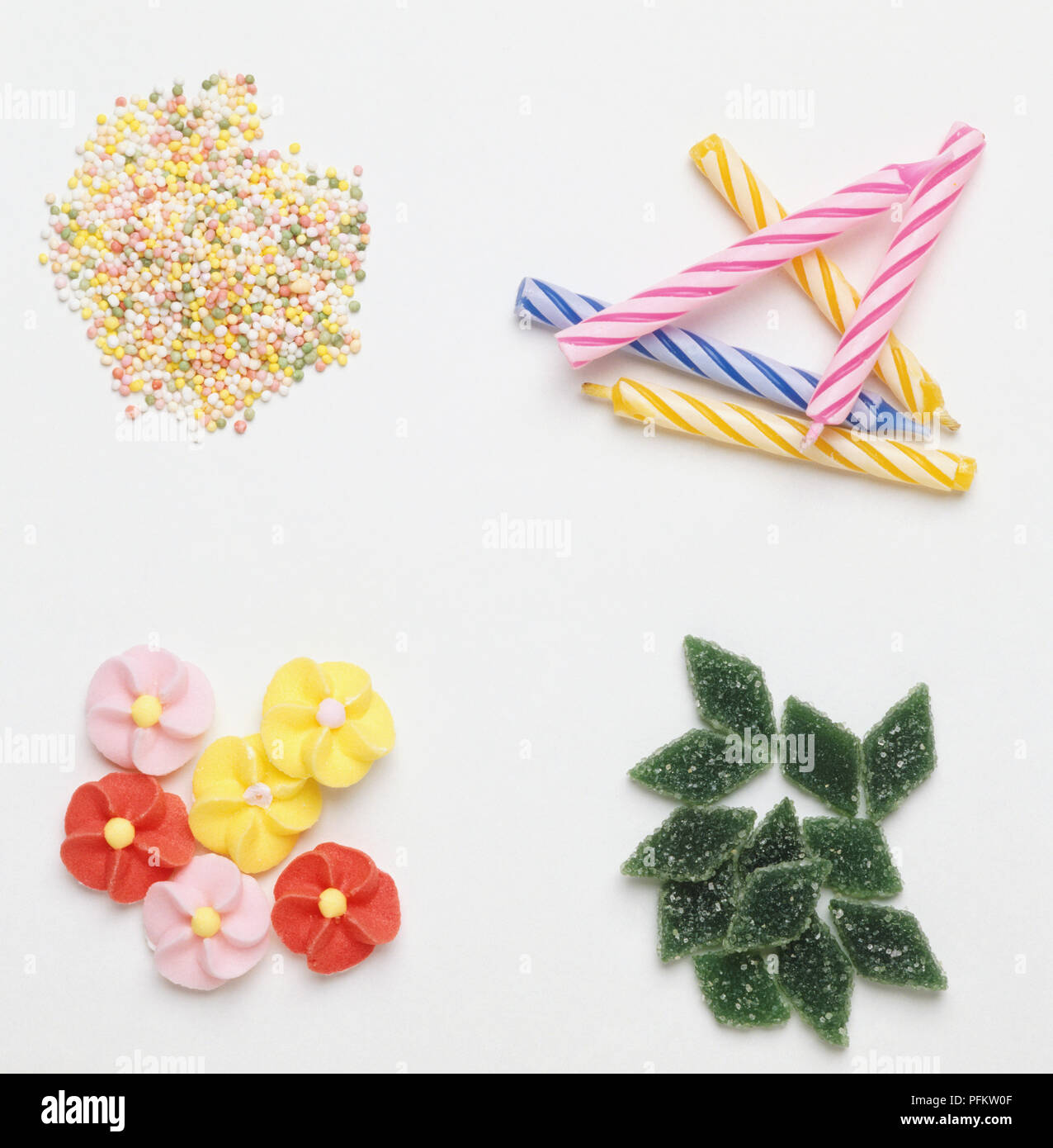 Selection Of Cake Decorations Sugared Green Diamond Sweets Marzipan Flowers Hundreds And Thousands Birthday Candles Close Up