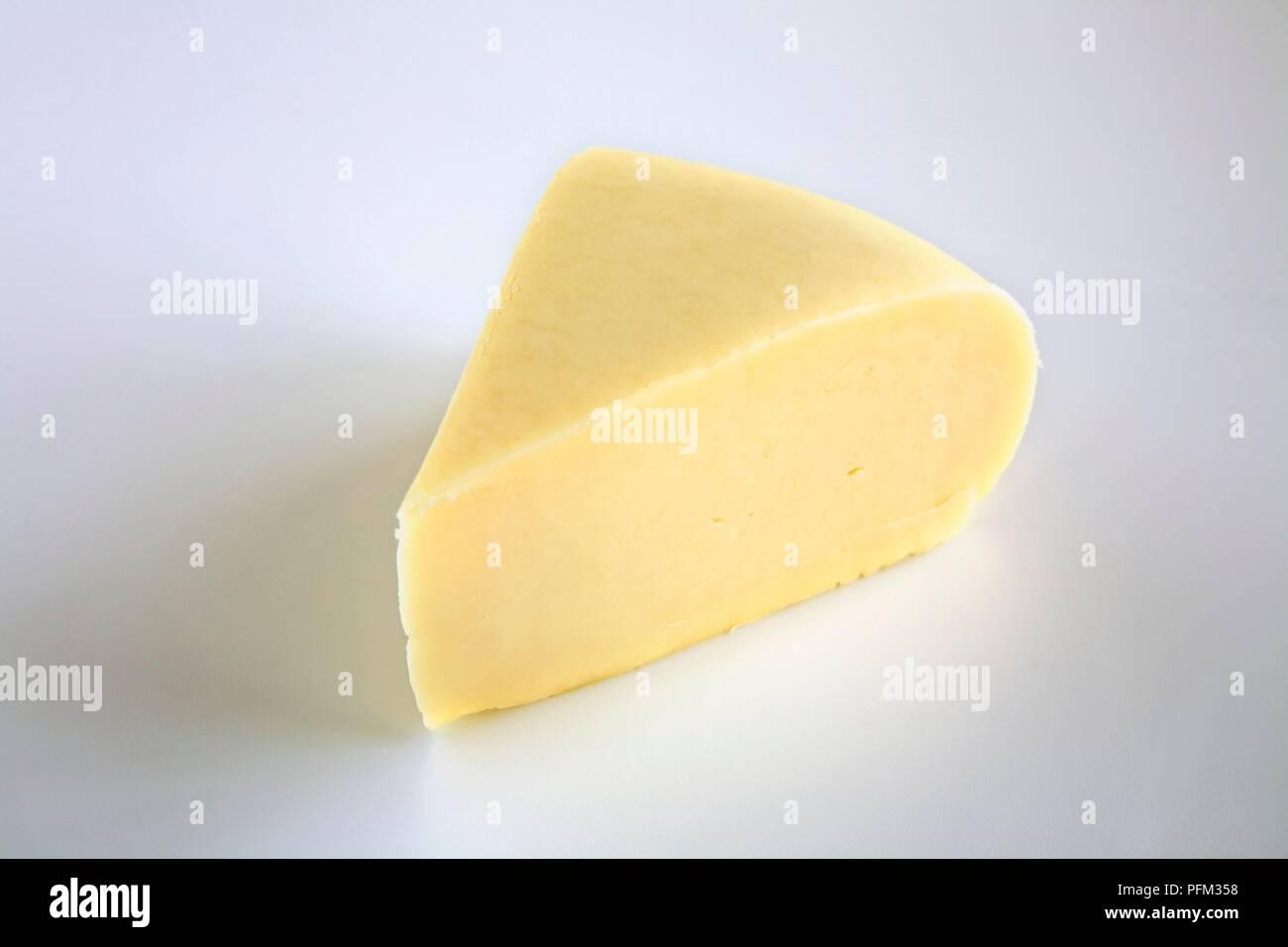Slice of American Monterey Jack cow's milk cheese Stock Photo