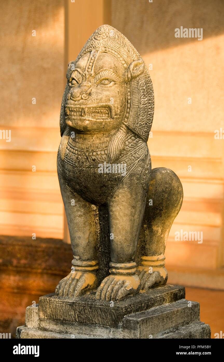 Thailand, Trat Province, Wat Plai Klong, also known as Wat Buppharam, stone lion Stock Photo