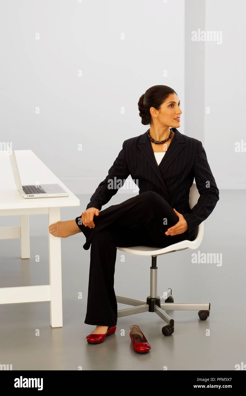 Fine Woman In Business Suit Performing Stretching Exercise While Gmtry Best Dining Table And Chair Ideas Images Gmtryco
