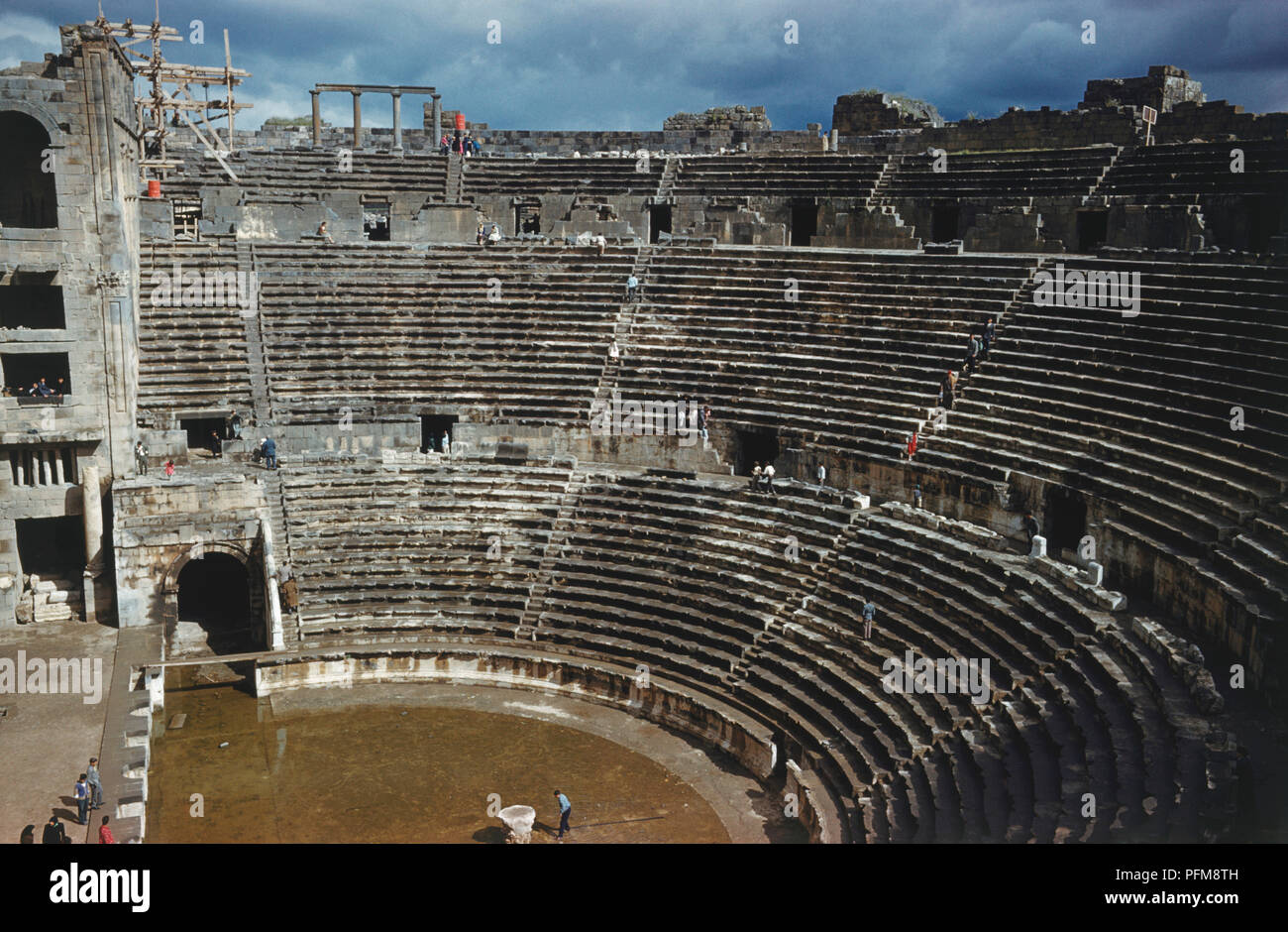 Syria, Bosra, second century Roman amphitheatre, viewed from high arena seating. - Stock Image