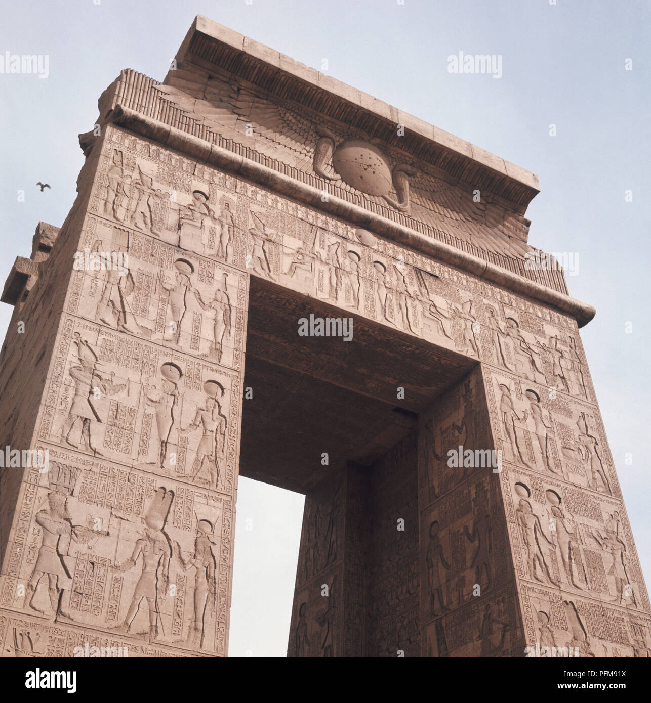 Egypt, Temple of Karnak complex, ornately carved Ptolemaic gateway of the 10th pylon, many hieroglyphic depictions. - Stock Image
