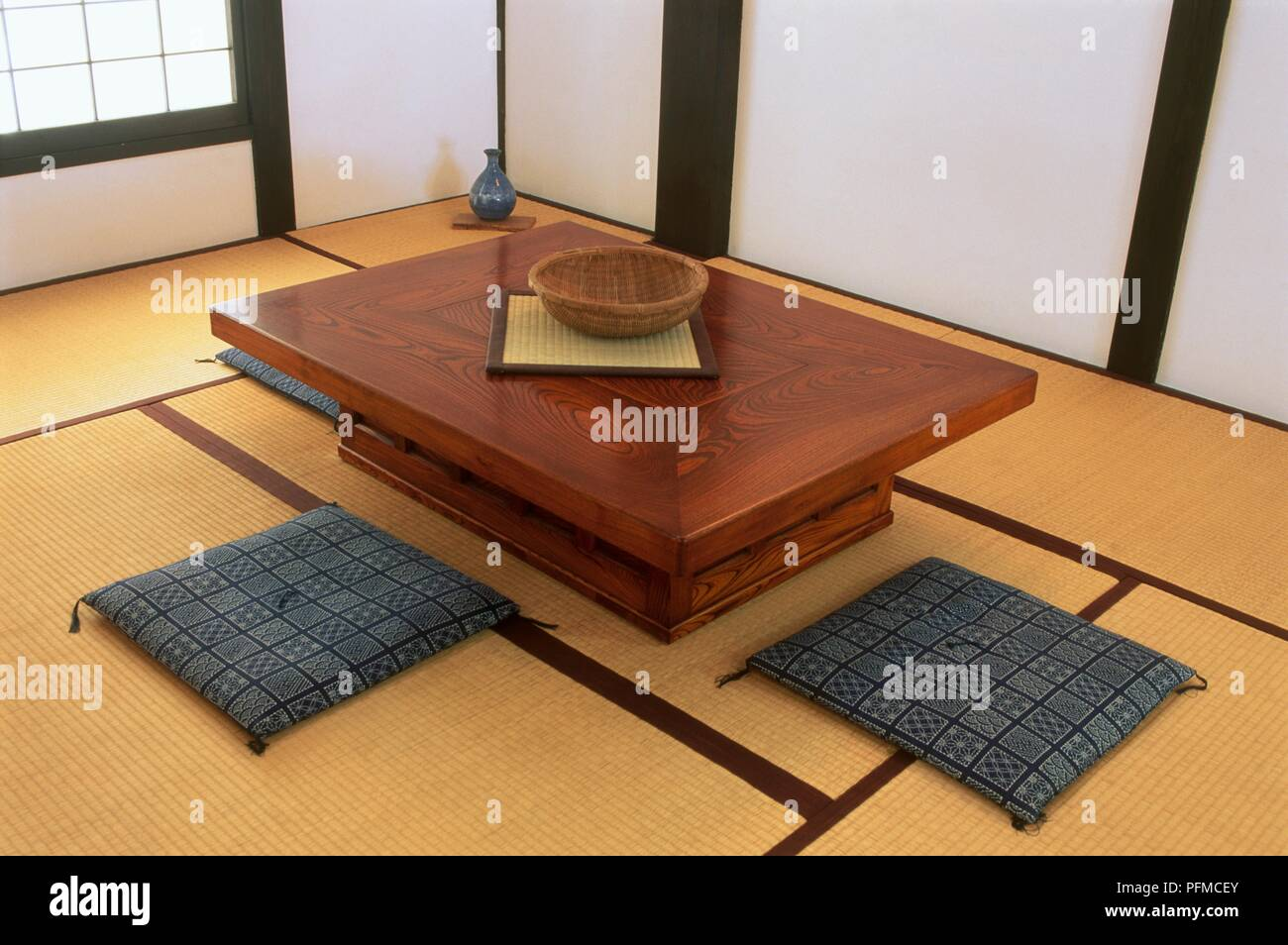 Japanese Kotatsu Table With Two Cushions On The Floor Stock Photo