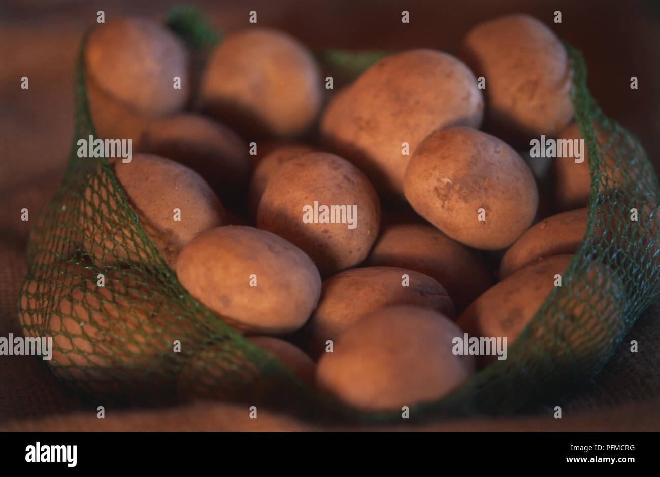 Bag of Potatoes. - Stock Image