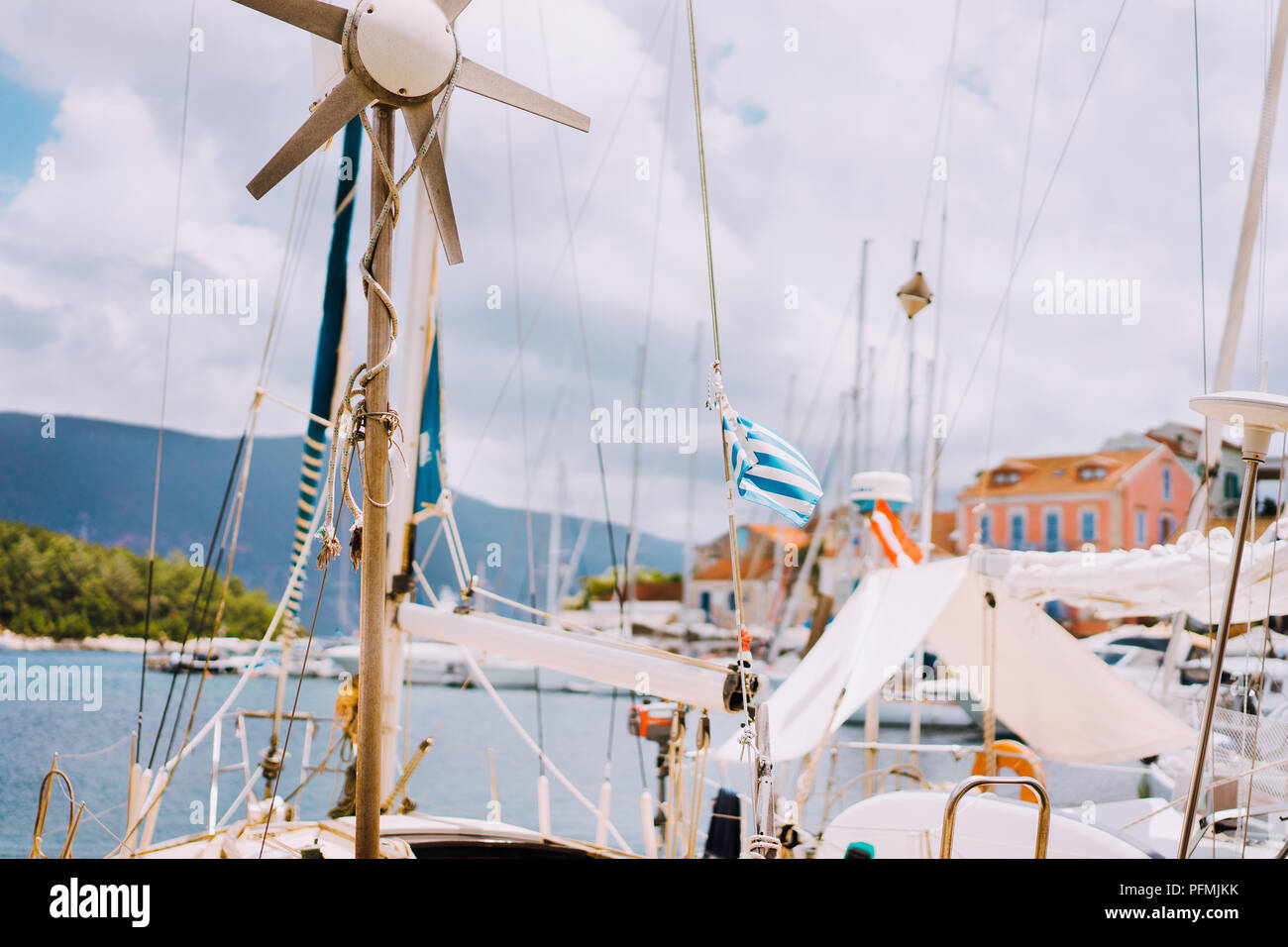 Sailboat detailed parts. Close up of masts of yacht over blue sea. Yachting concept. Soft focus - Stock Image