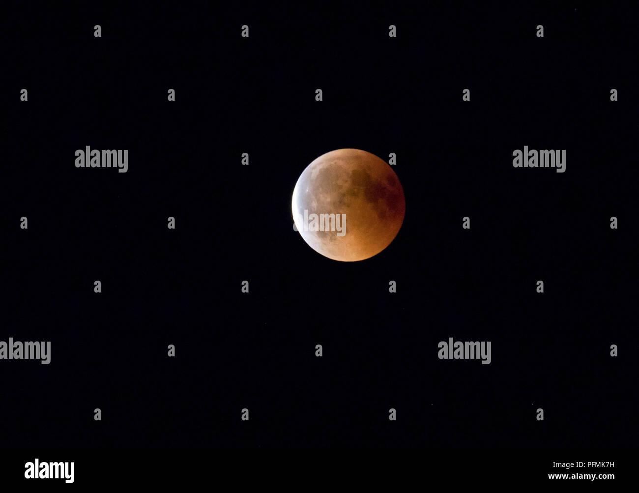 Full moon, blood moon in total lunar eclipse, 27.07.2018, Rosenheim, Bavaria, Germany - Stock Image