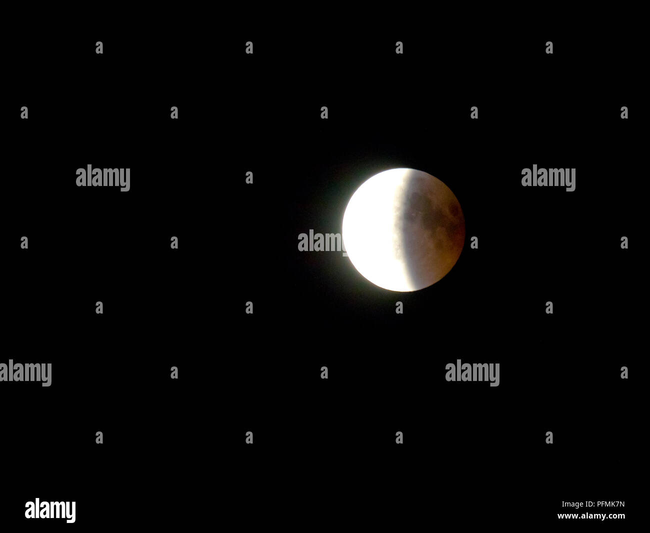 Full moon, moon emerges from Earth's shadow, total lunar eclipse, 07/27/2018, Rosenheim, Bavaria, Germany - Stock Image