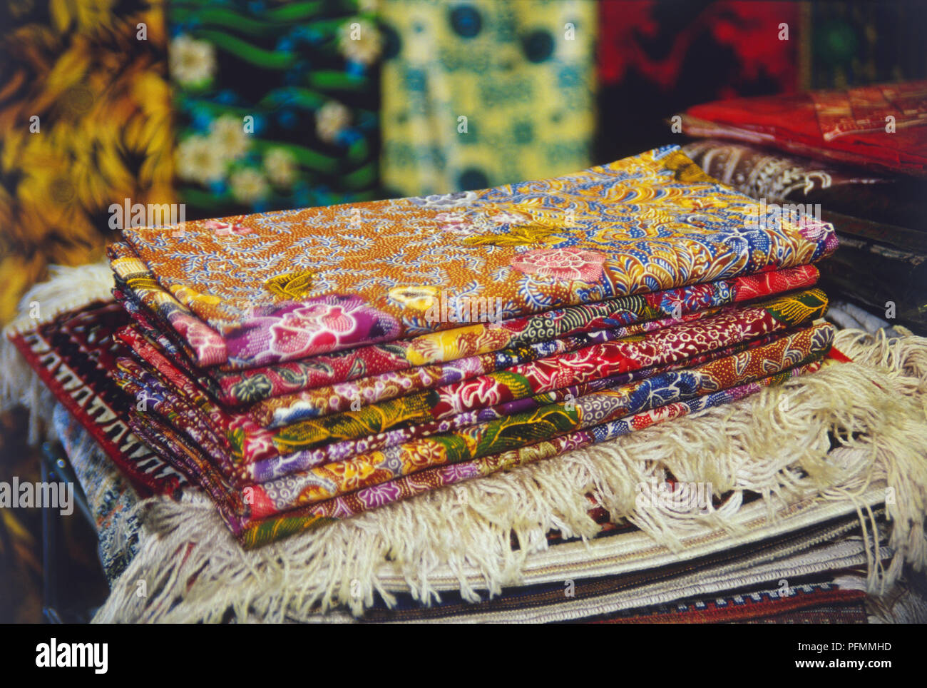 Singapore, pile of traditional oriental textiles, vivid