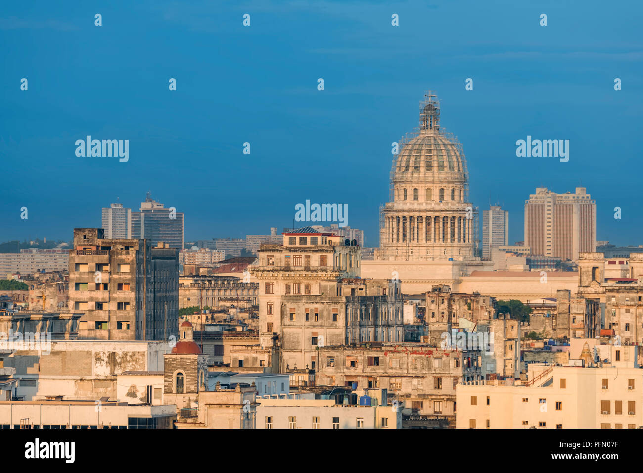 dilapidated stone buildings of an ancient city with a dome of the capitol on a blue background of a clear tropical sky