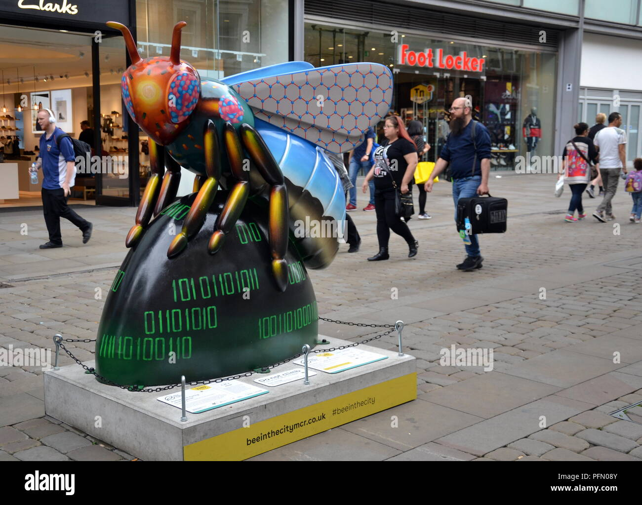 People in Manchester explore the 'Bee in the City' free, family-fun trail. Over 100 Bees are in the trail which ends 23 September. - Stock Image