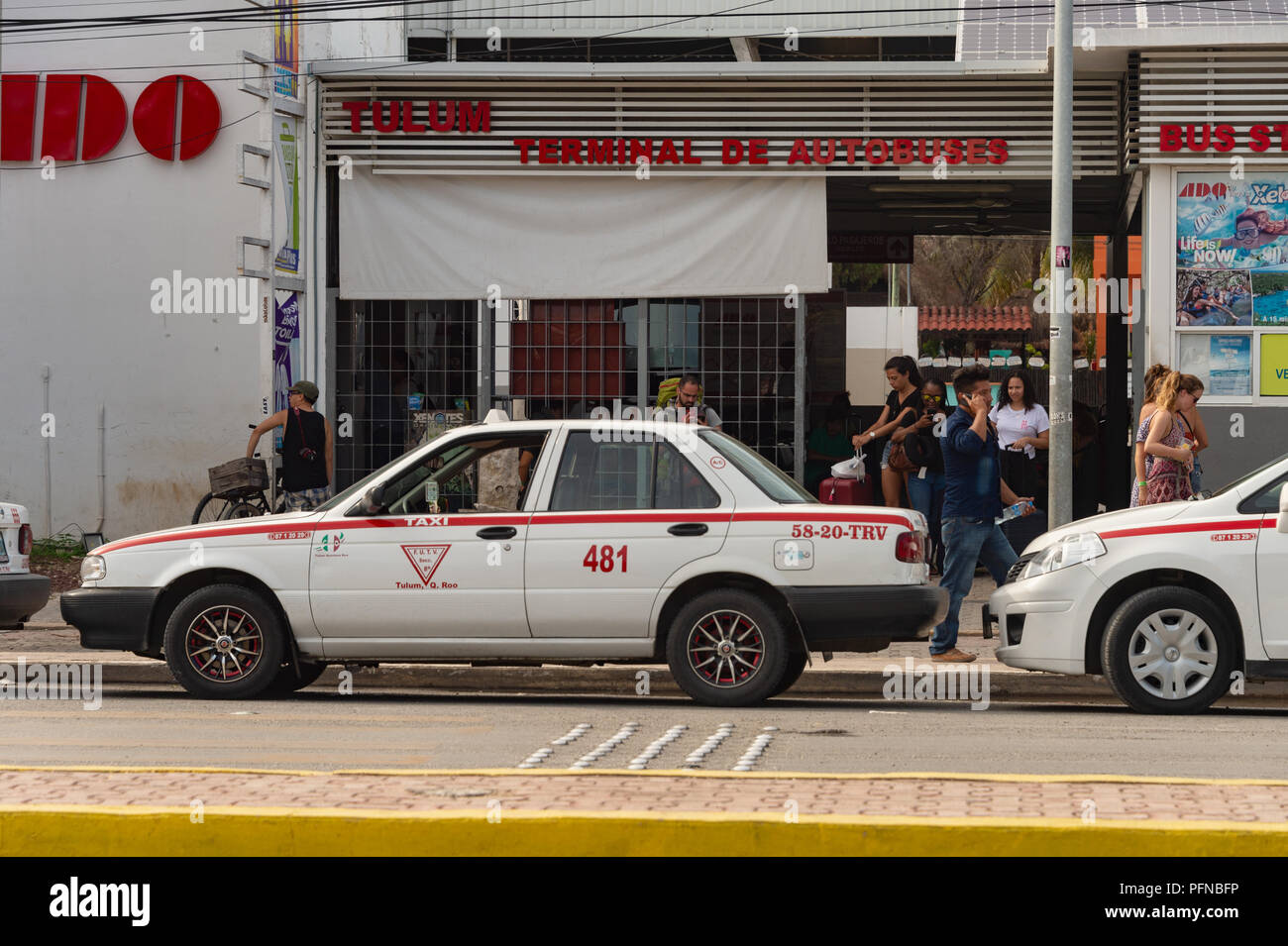 Tulum, Mexico - 7 August 2018: ADO Autobus Terminal with tourists and taxis. Stock Photo