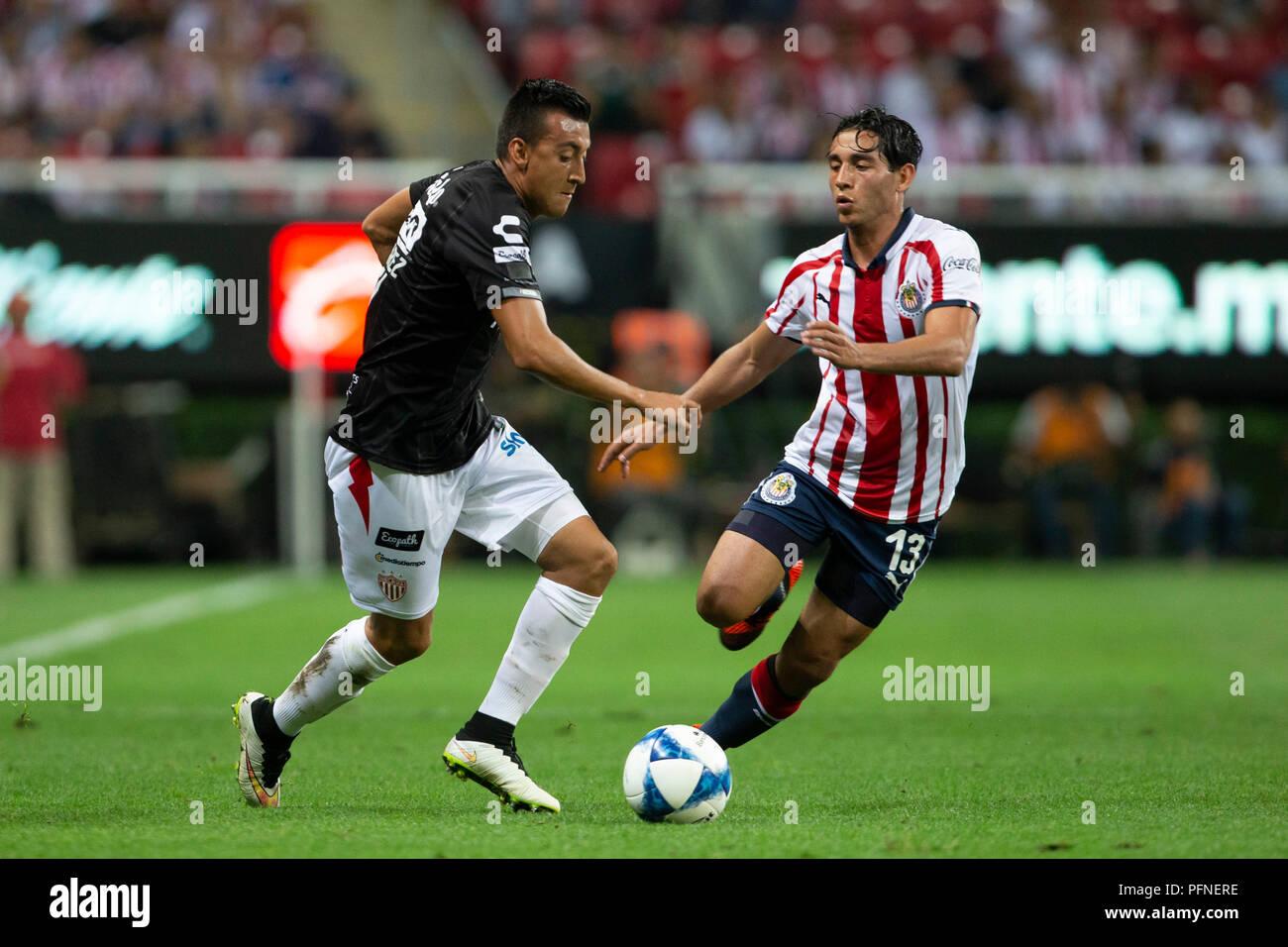 074b34b4f44 Gael Sandoval (R) of Chivas vies for the ball with Daniel Alvarez (L