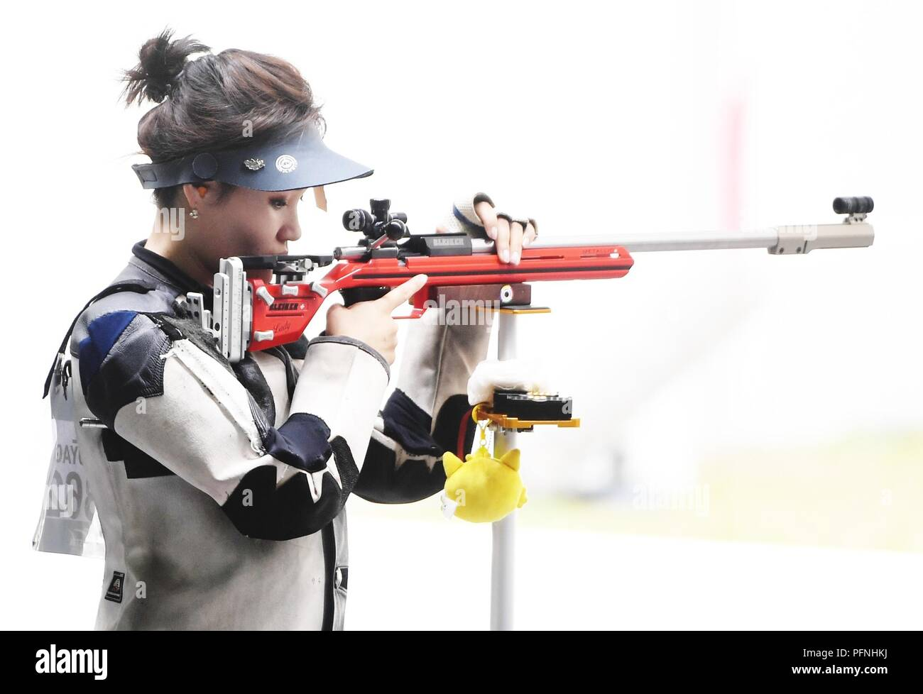 Palembang. 22nd Aug, 2018. Nandinzaya Gankhuyag of Mongolia competes during the women's 50m rifle 3 positions final at the 18th Asian Games in Palembang, Indonesia on Aug. 22, 2018. Credit: Wang Shen/Xinhua/Alamy Live News - Stock Image