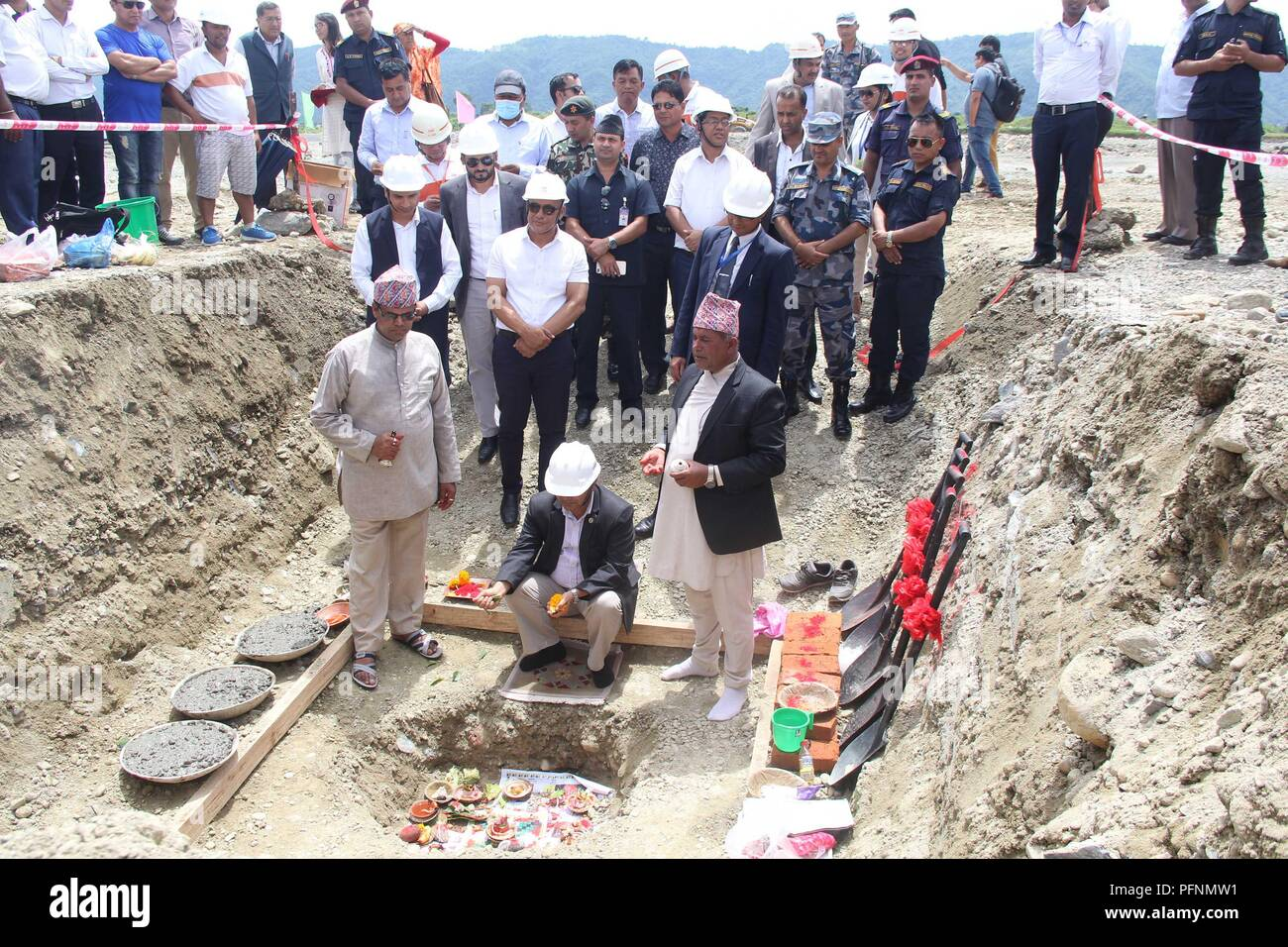 (180823) -- POKHARA, Aug. 23, 2018 -- Nepali Minister for Culture, Tourism and Civil Aviation Rabindra Adhikari lays the foundation stone of the construction of the terminal buildings at China-assisted Pokhara international airport in Pokhara,Nepal, Aug. 22 , 2018. Construction of two separate terminal buildings, one for international and another for domestic flights, began at the China-assisted Pokhara international airport on Wednesday. (Xinhua/Krishna Mani Baral)(dh) - Stock Image