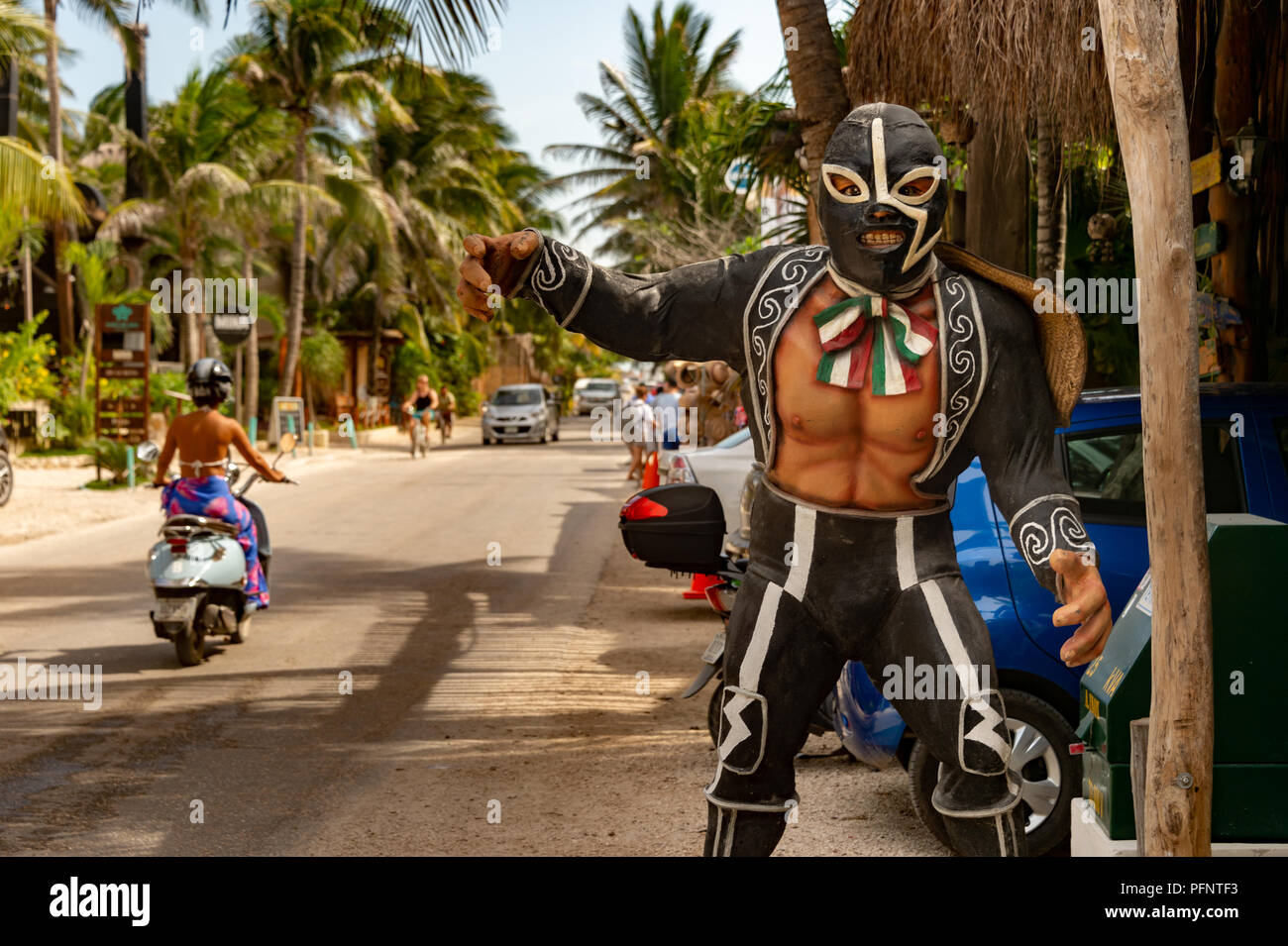 Tulum, Mexico - 14 August 2018: Mexican westler statue with traditional costume on Carretera Tulum Boca Paila road. - Stock Image